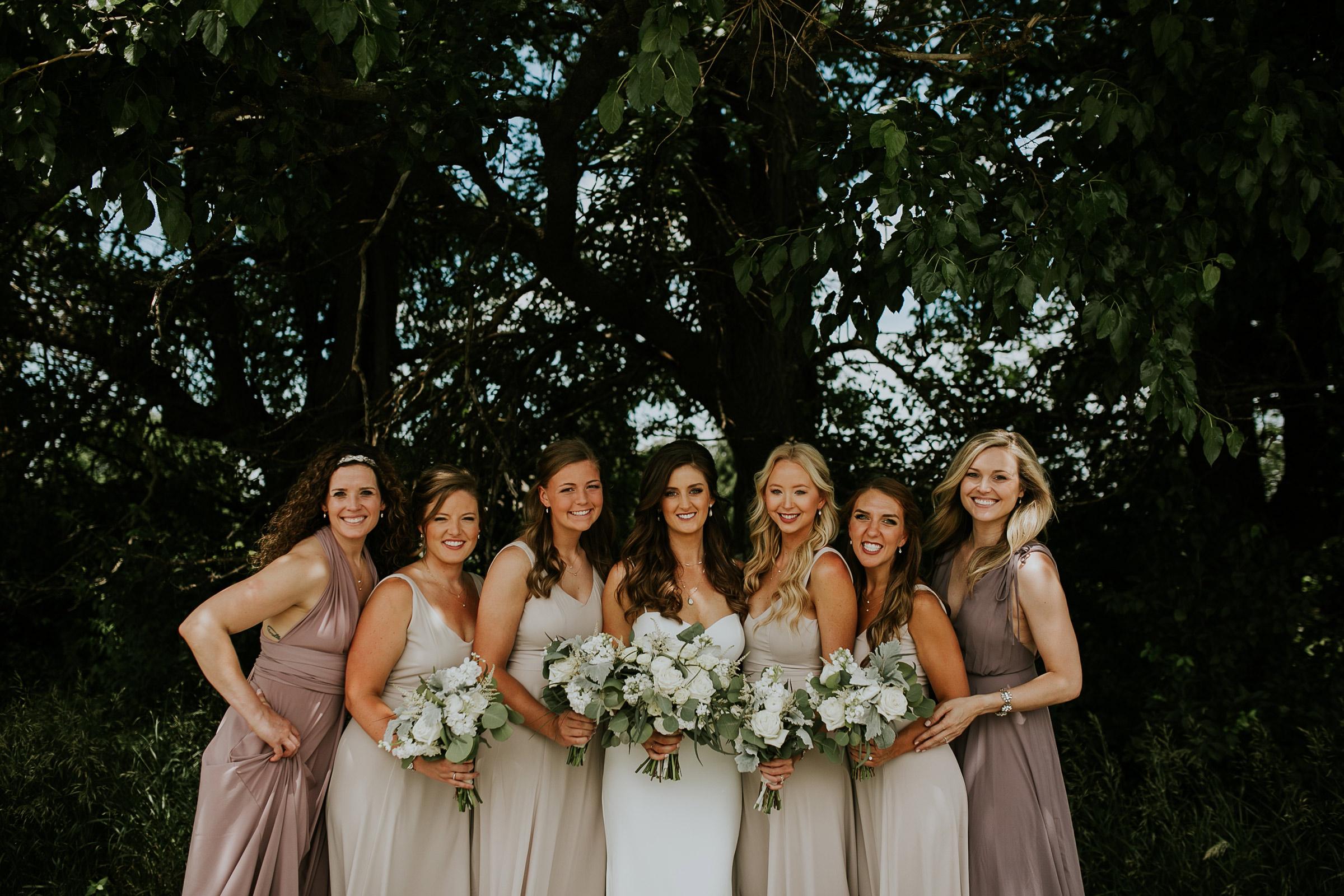 mr-mrs-hull-bride-with-bridesmaids-posing-at-st-boniface-church-waukee-desmoines-iowa-raelyn-ramey-photography-208.jpg