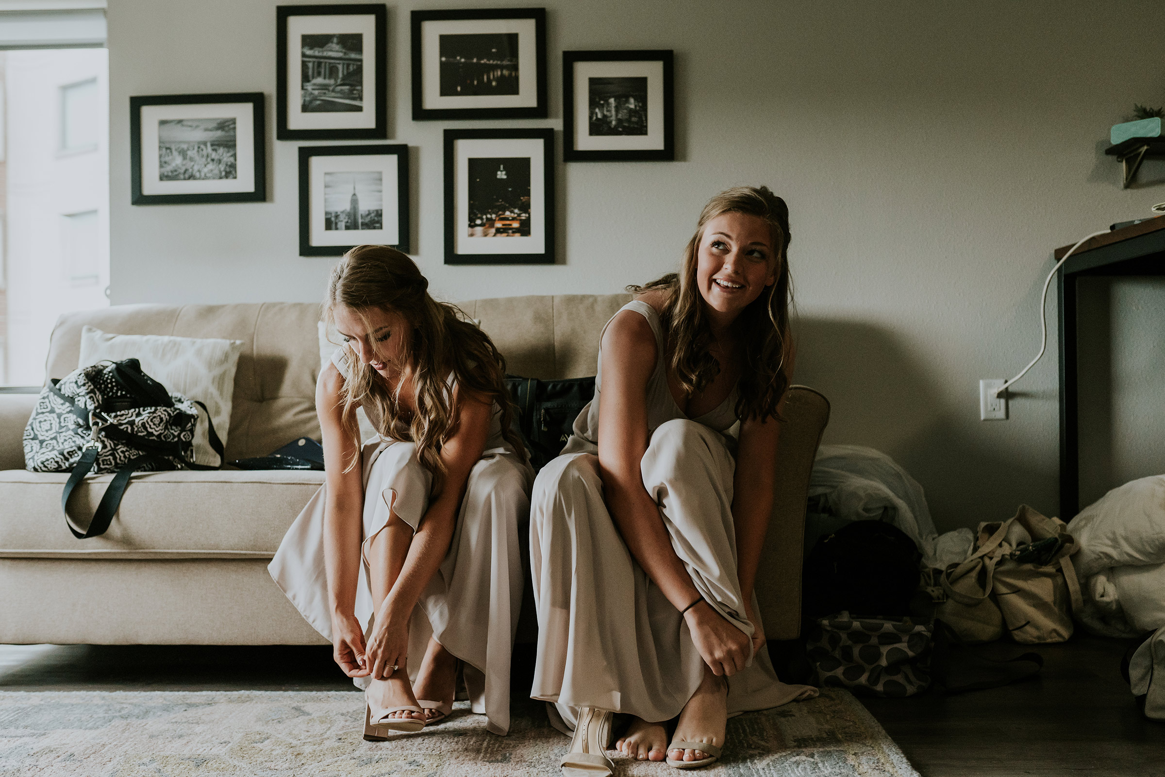 mr-mrs-hull-bridesmaids-putting-shoes-on-desmoines-iowa-raelyn-ramey-photography-61.jpg