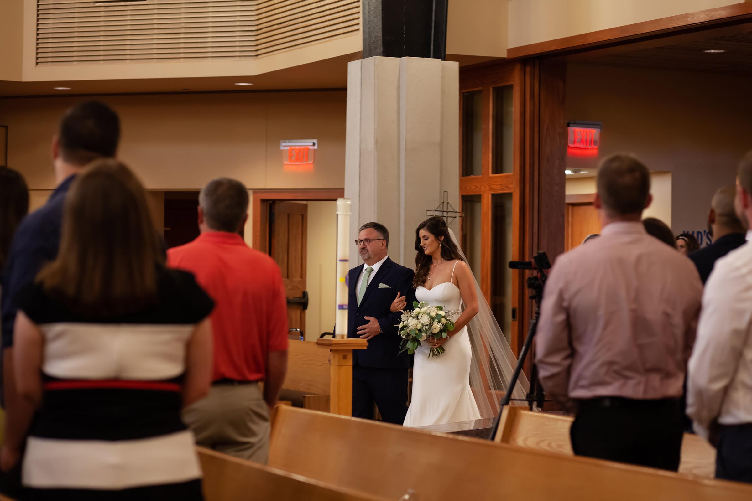 mr-mrs-hull-dad-walking-bride-down-aisle-st-boniface-church-waukee-desmoines-iowa-raelyn-ramey-photography-317.jpg