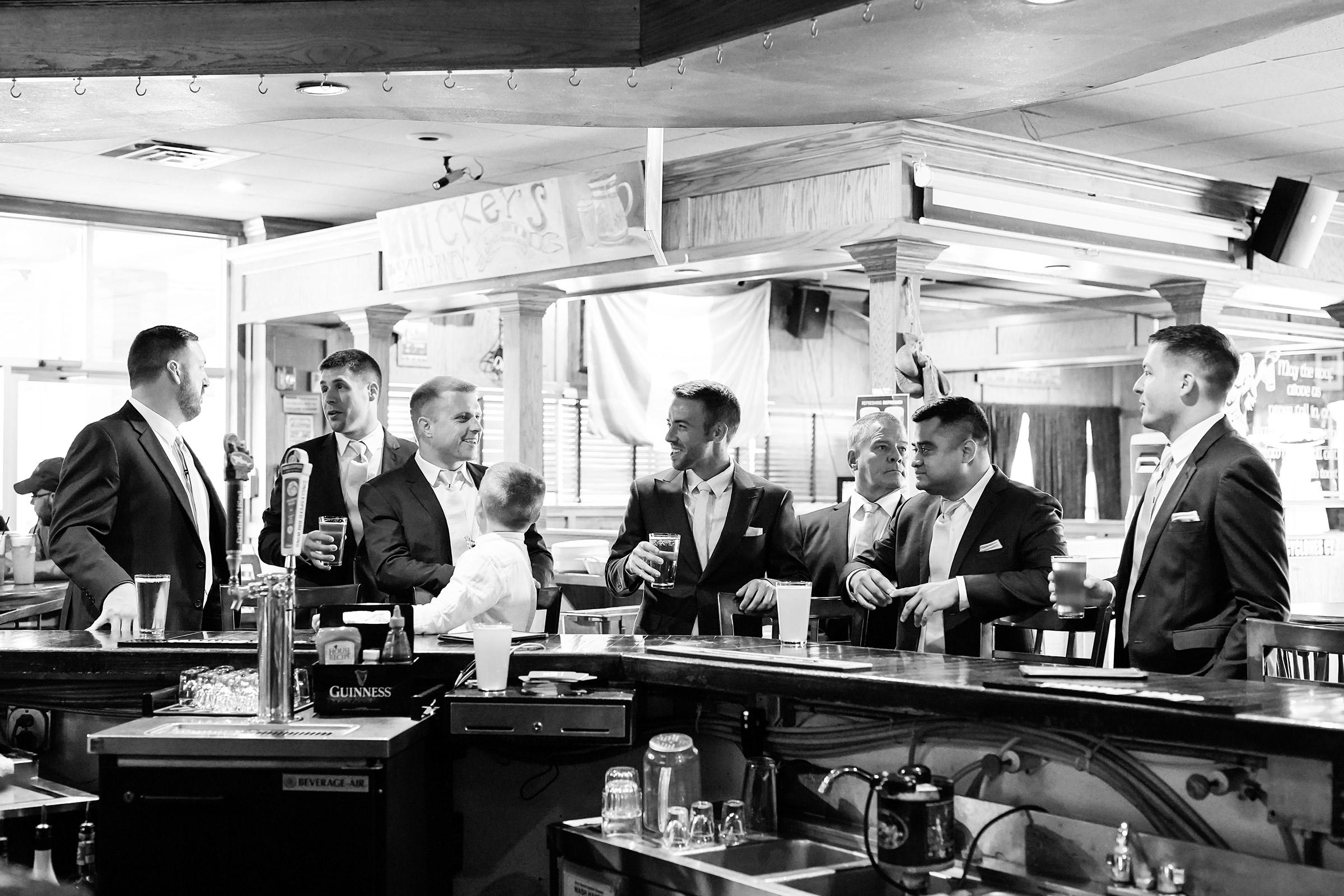 mr-mrs-hull-groom-and-groomsmen-at-mickey's-irish-pub-waukee-desmoines-iowa-raelyn-ramey-photography-161.jpg