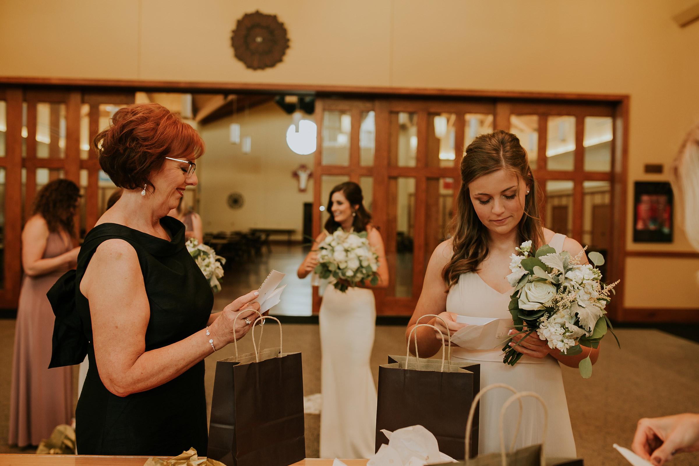 mr-mrs-hull-mother-of-bride-opening-gift-st-boniface-church-waukee-desmoines-iowa-raelyn-ramey-photography-193.jpg