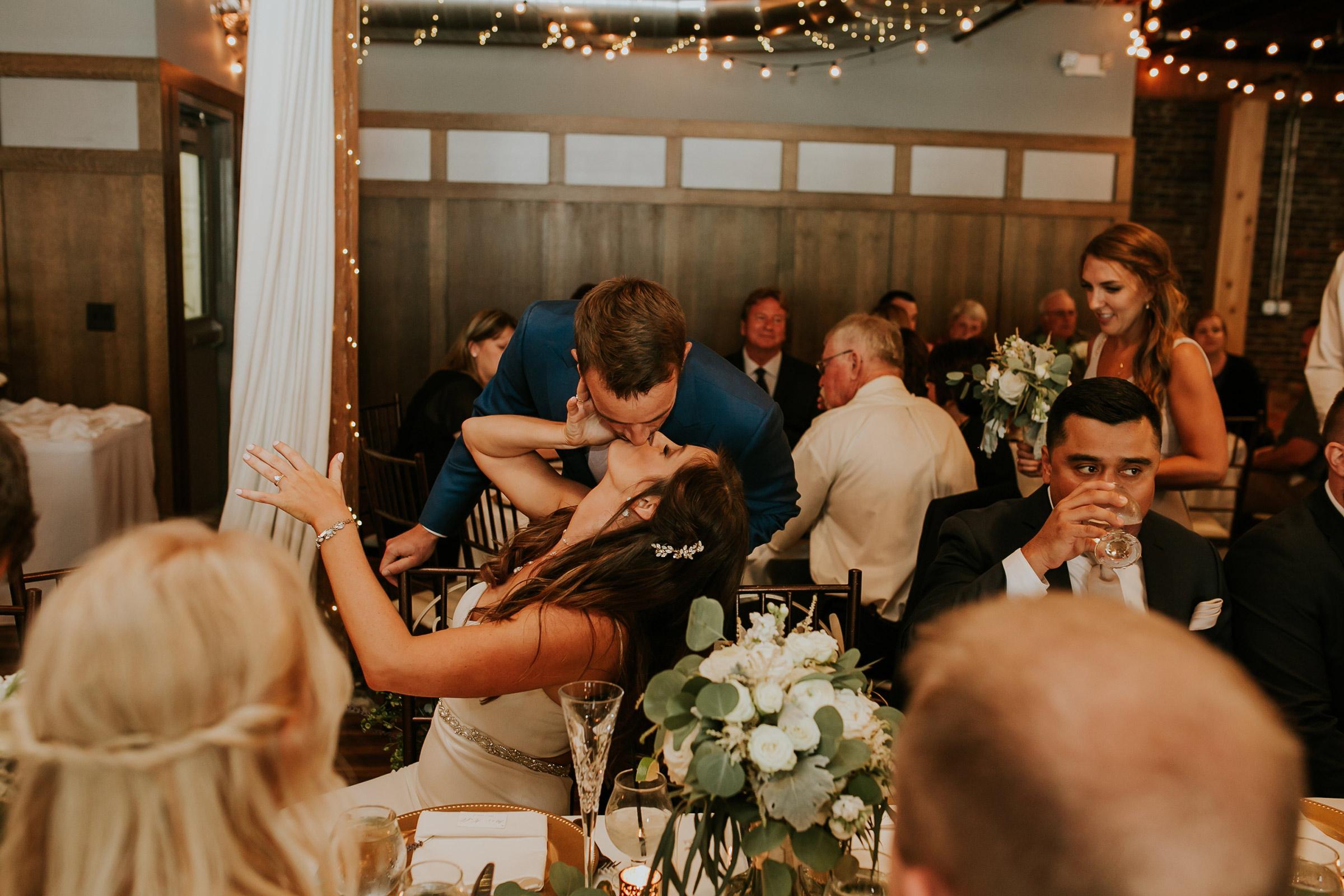 mr-mrs-hull-couple-kissing-reception-taproom-desmoines-iowa-raelyn-ramey-photography-546.jpg