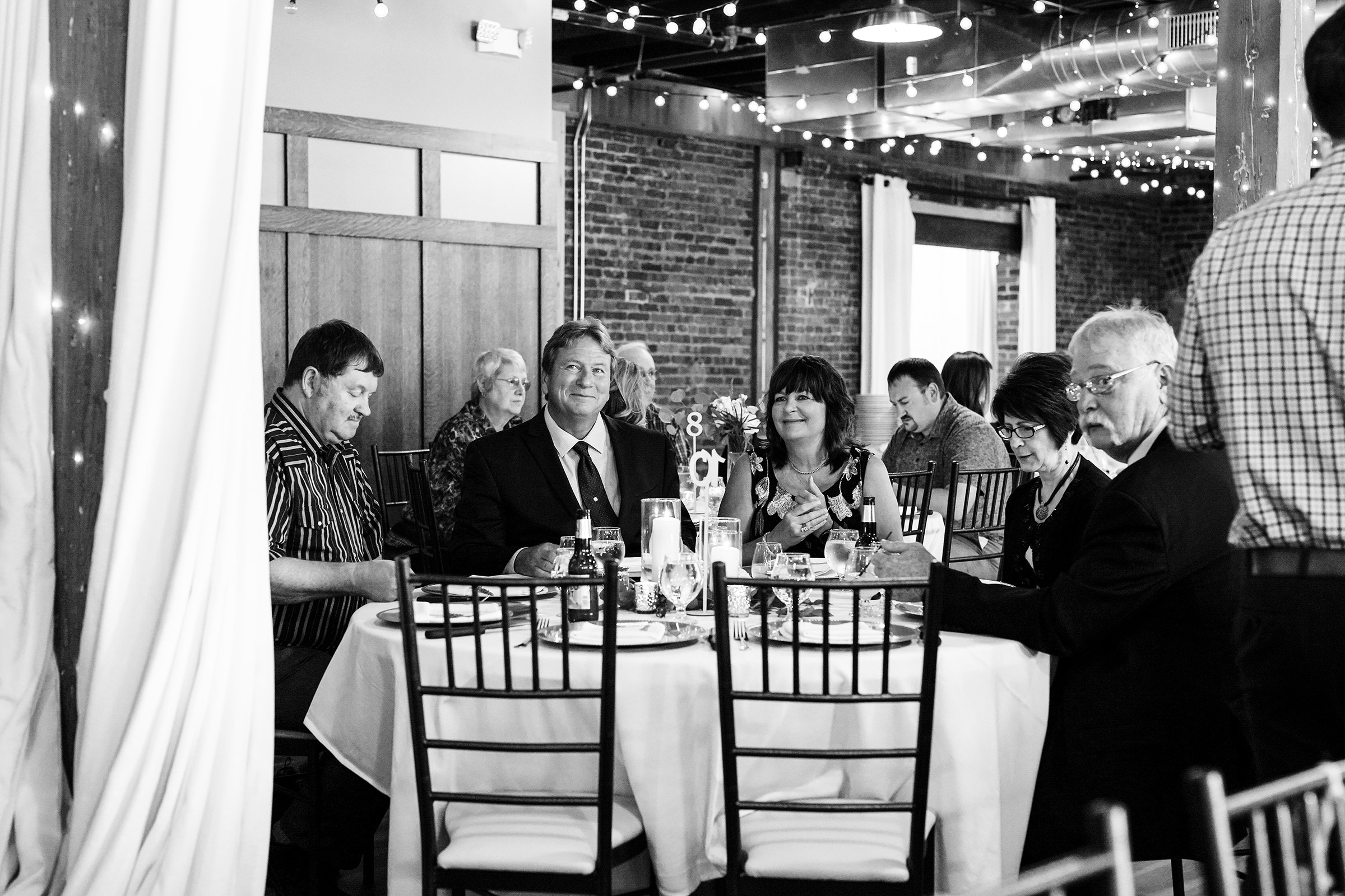 mr-mrs-hull-guests-watching-wedding-party-taproom-desmoines-iowa-raelyn-ramey-photography-537.jpg