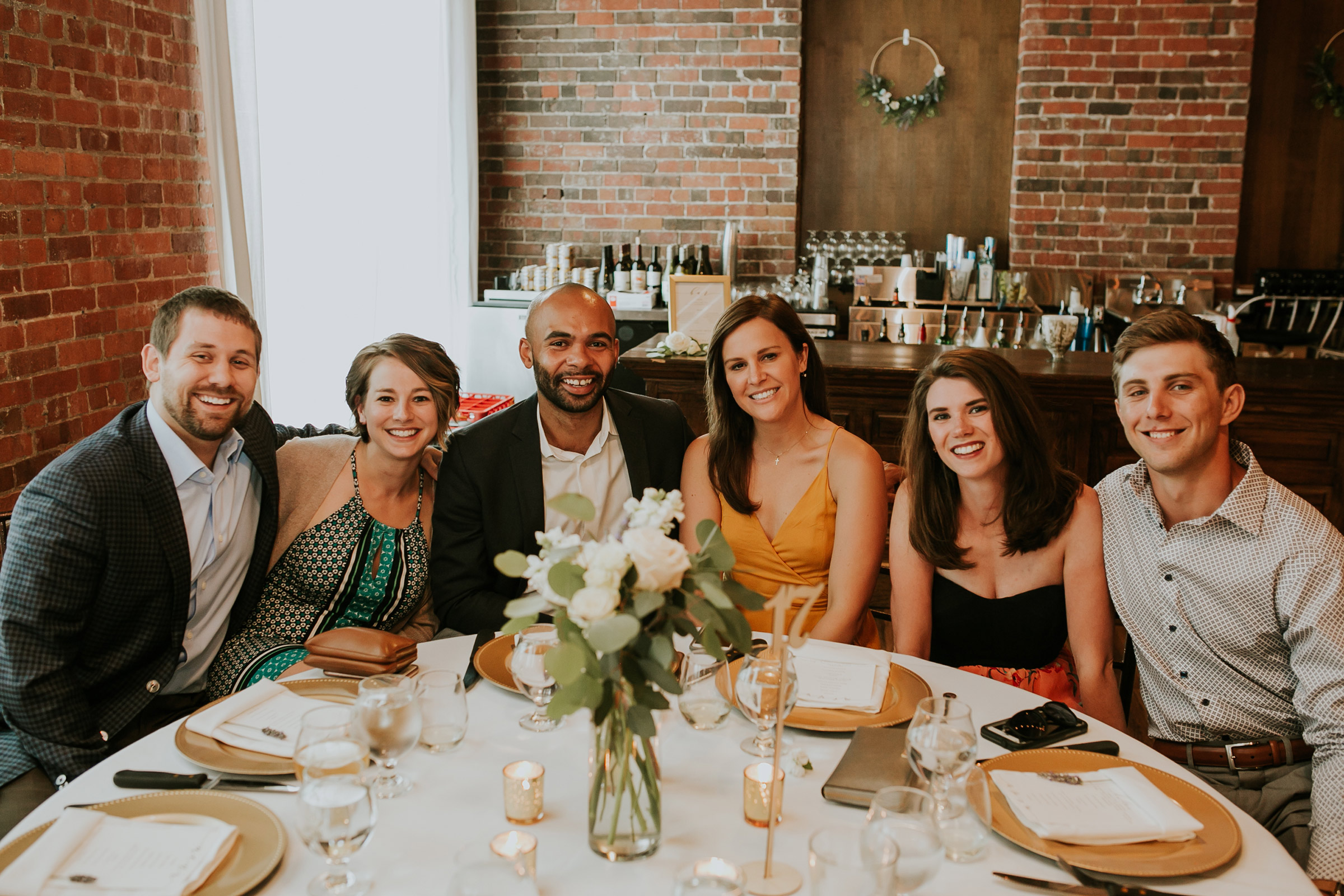 mr-mrs-hull-reception-guests-at-table-taproom-desmoines-iowa-raelyn-ramey-photography-557.jpg