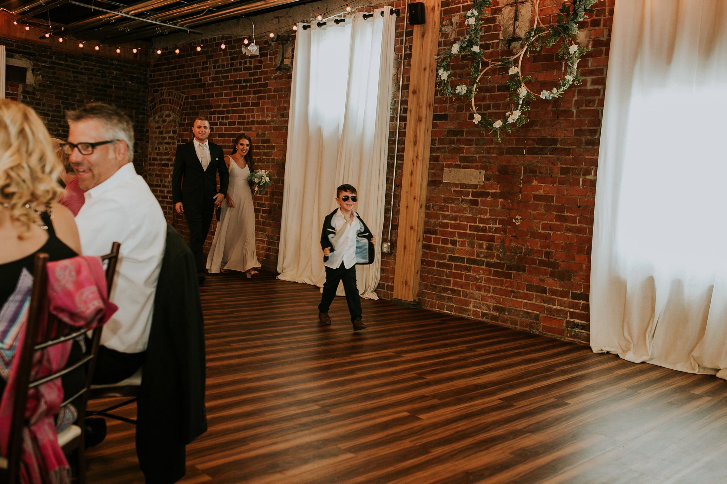mr-mrs-hull-wedding-guests-enterance-little-boy-taproom-desmoines-iowa-raelyn-ramey-photography-539.jpg