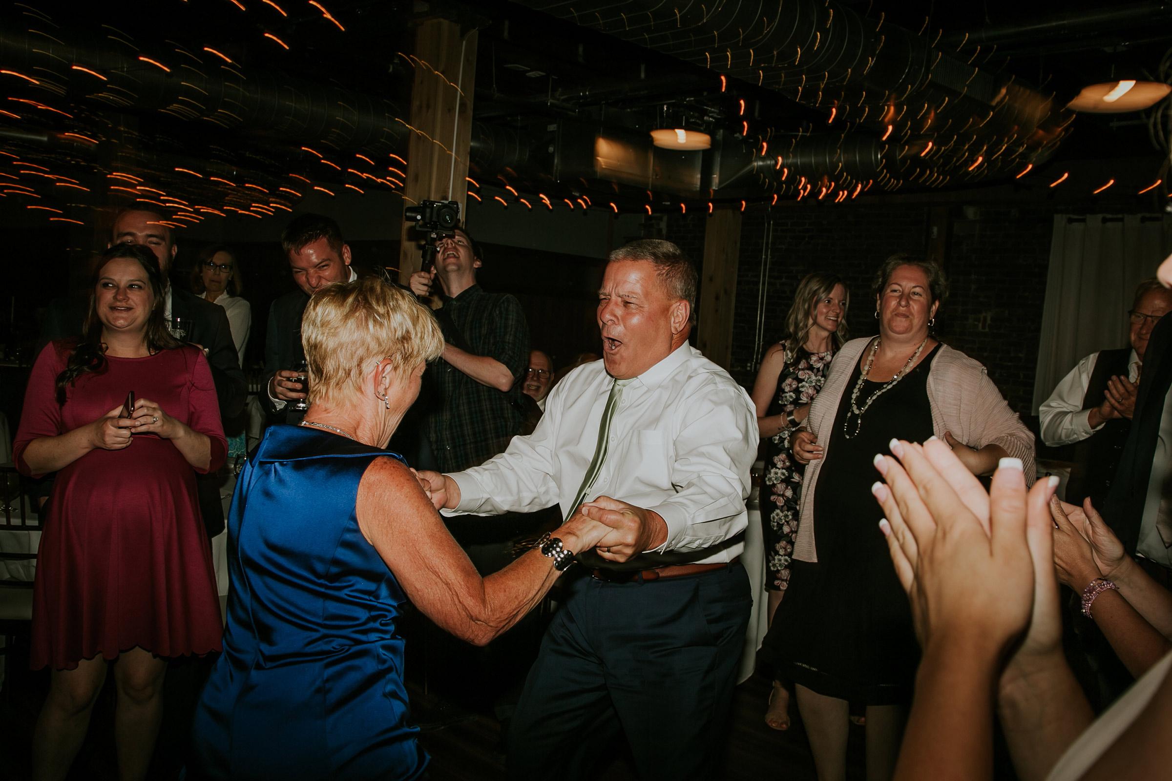 mr-mrs-hull--guests-dancing-iowa-taproom-desmoines-iowa-raelyn-ramey-photography-767.jpg