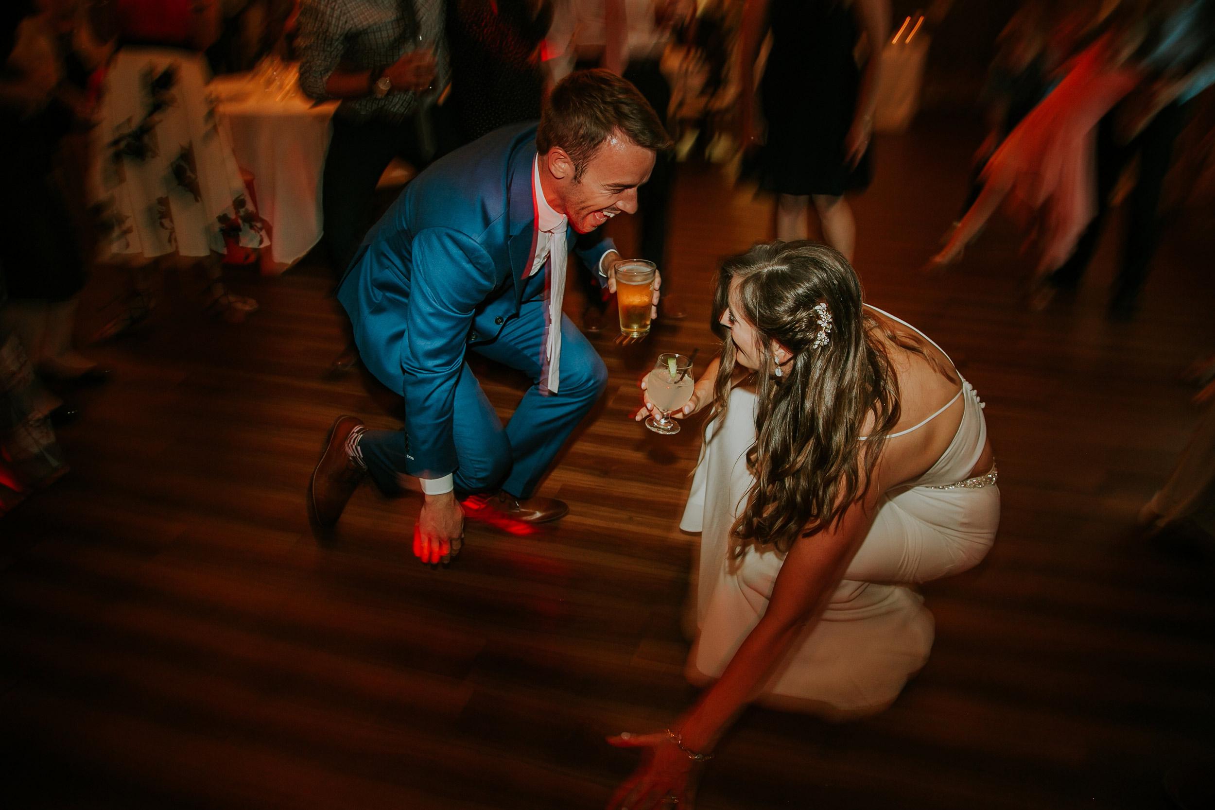 mr-mrs-hull-couple-dancing-on-floor-iowa-taproom-desmoines-iowa-raelyn-ramey-photography-19.jpg