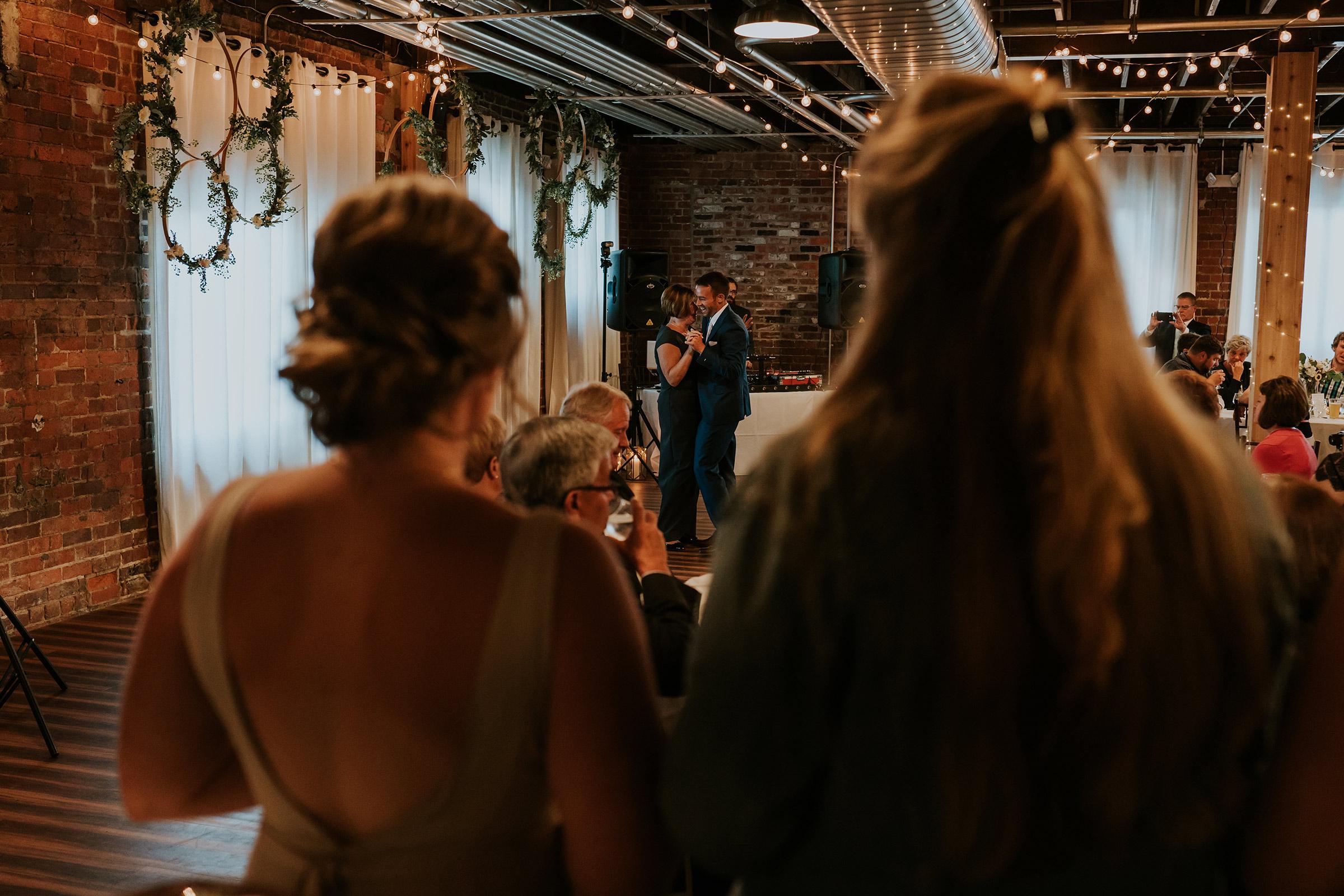 mr-mrs-hull-wedding-groom-mother-dance-guest-watching-iowa-taproom-desmoines-iowa-raelyn-ramey-photography-609.jpg