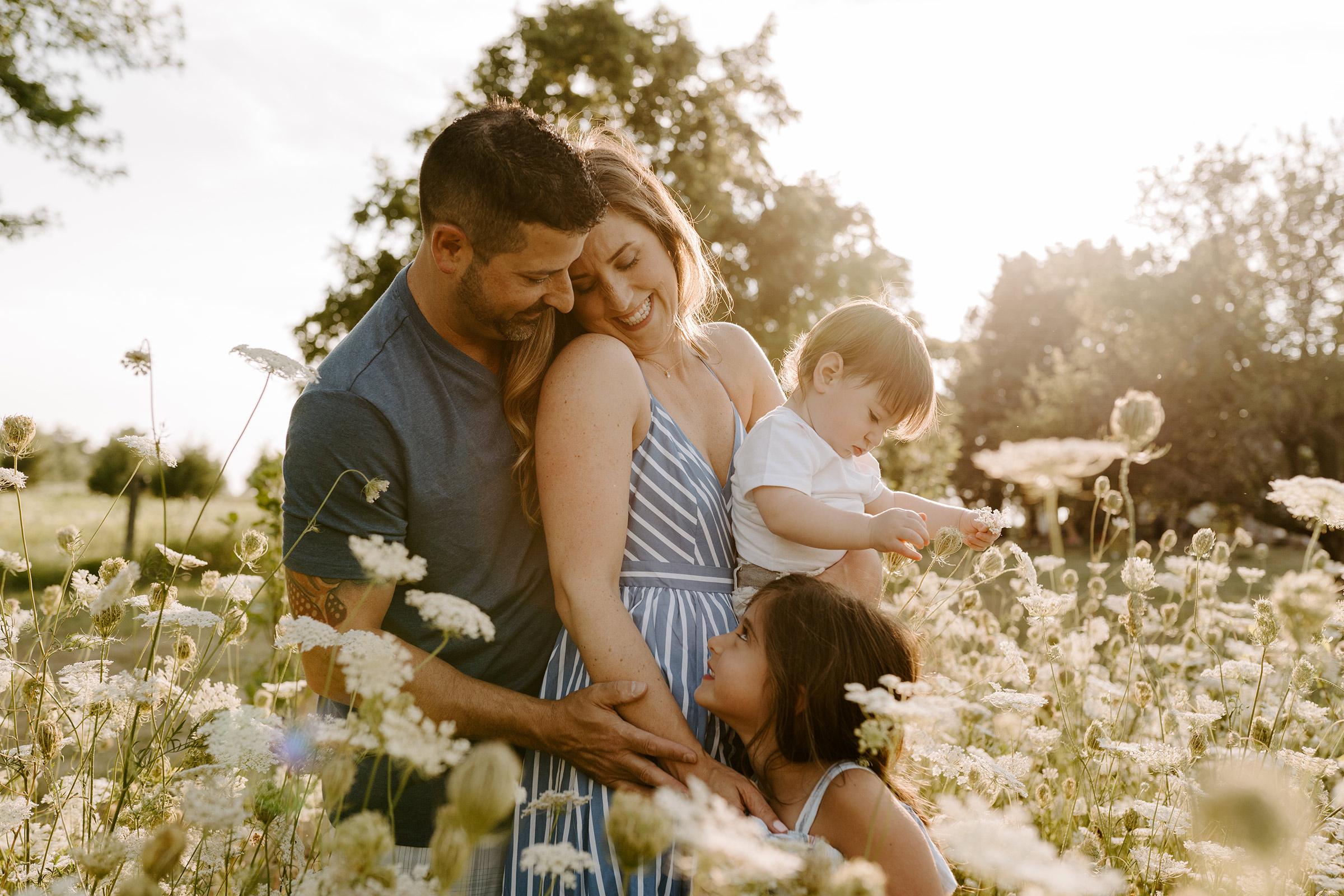 natale-family--walking-through-flowers-iris-aisle--winterset-iowa-raelyn-ramey-photography-62.jpg
