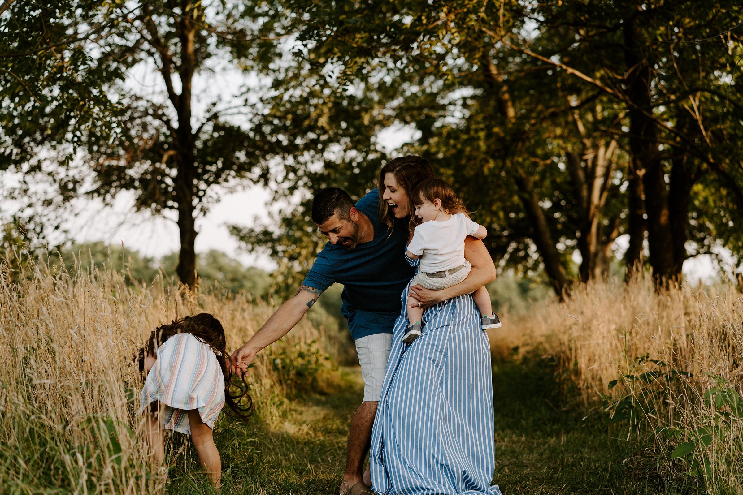 natale-family-chasing-daughter-around-at-iris-aisle--winterset-iowa-raelyn-ramey-photography-158.jpg