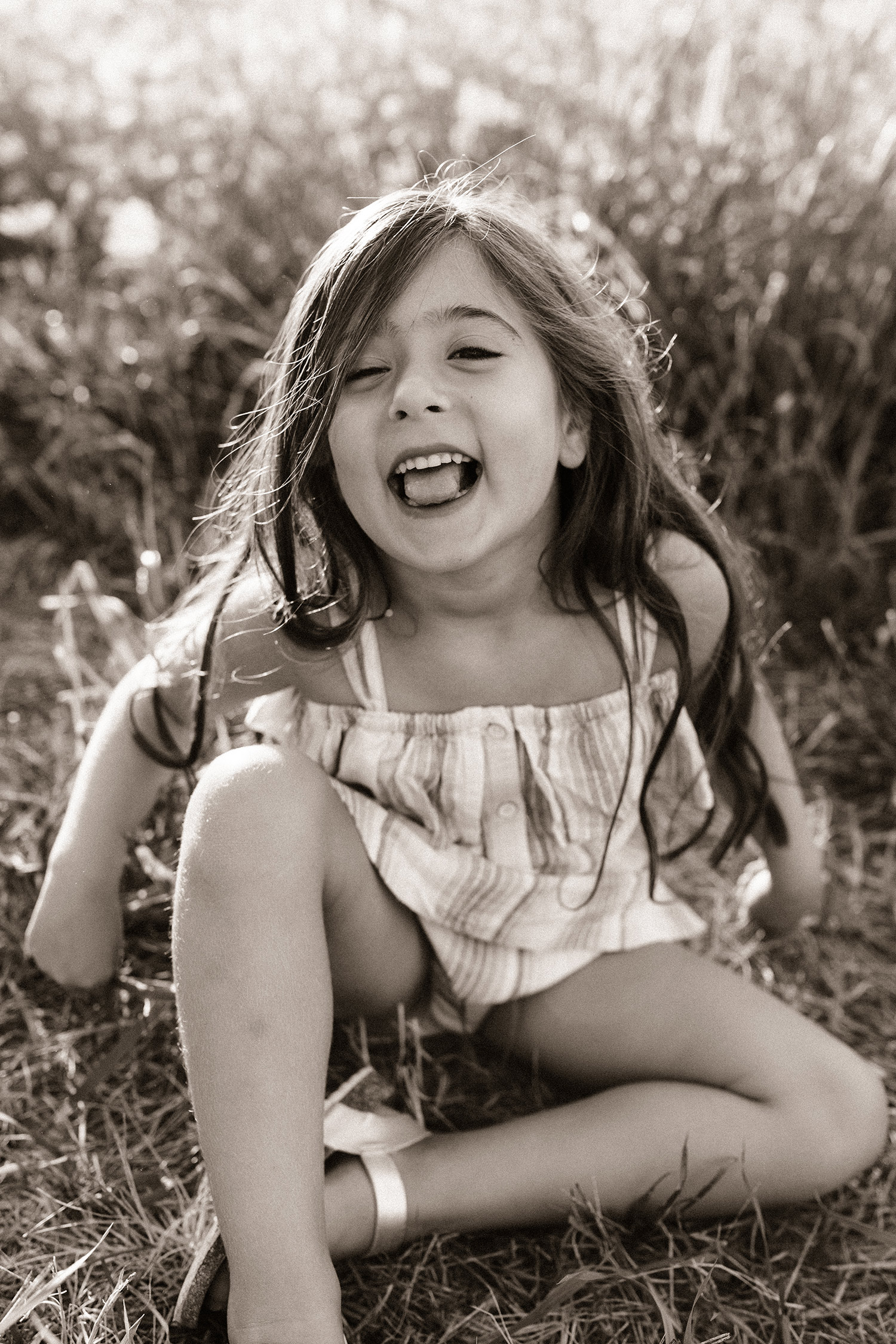 natale-family-daughter-laughing-in-grass-iris-aisle--winterset-iowa-raelyn-ramey-photography-44.jpg