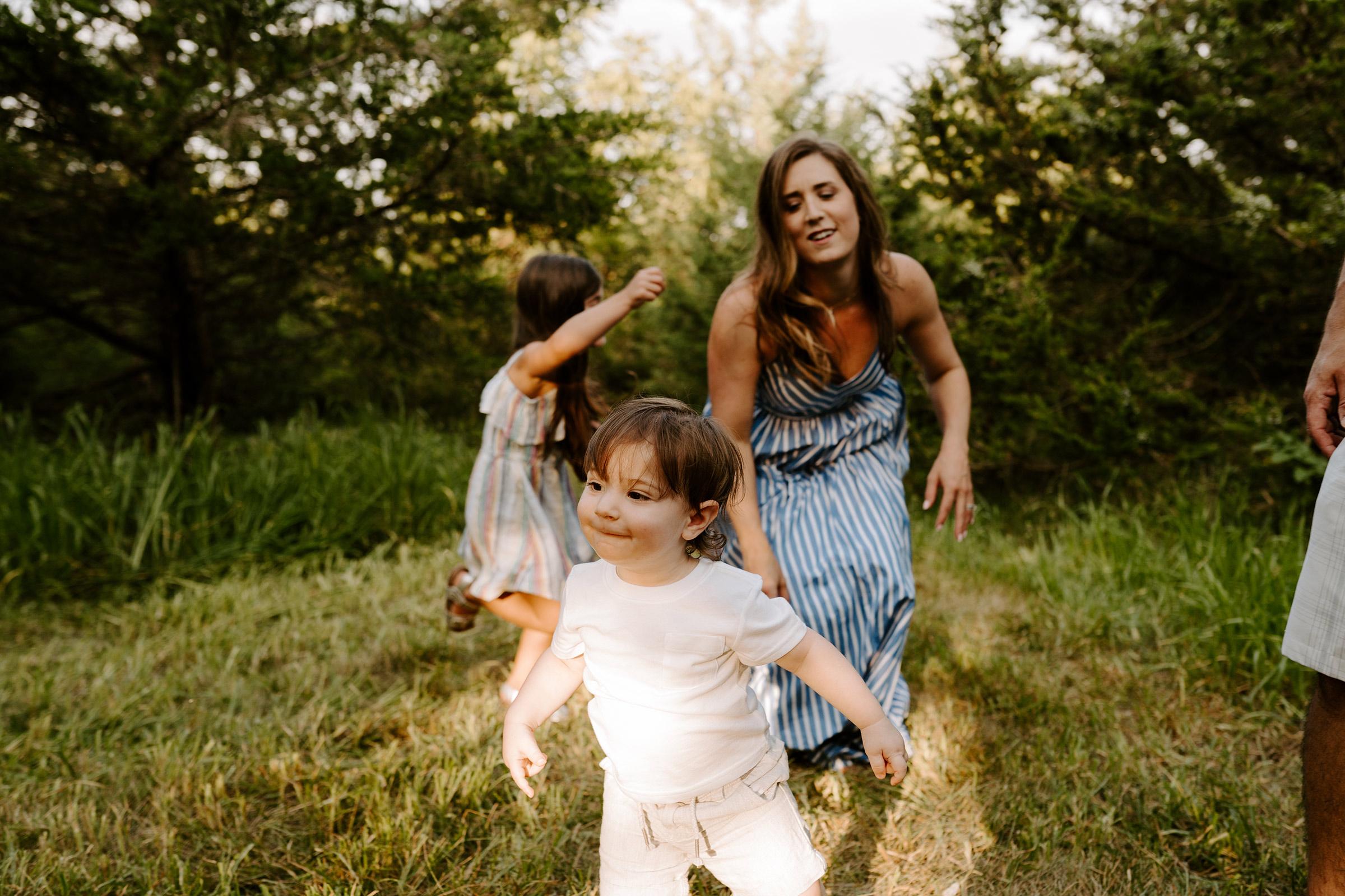 natale-family-mom-chasing-son-iris-aisle--winterset-iowa-raelyn-ramey-photography-96.jpg