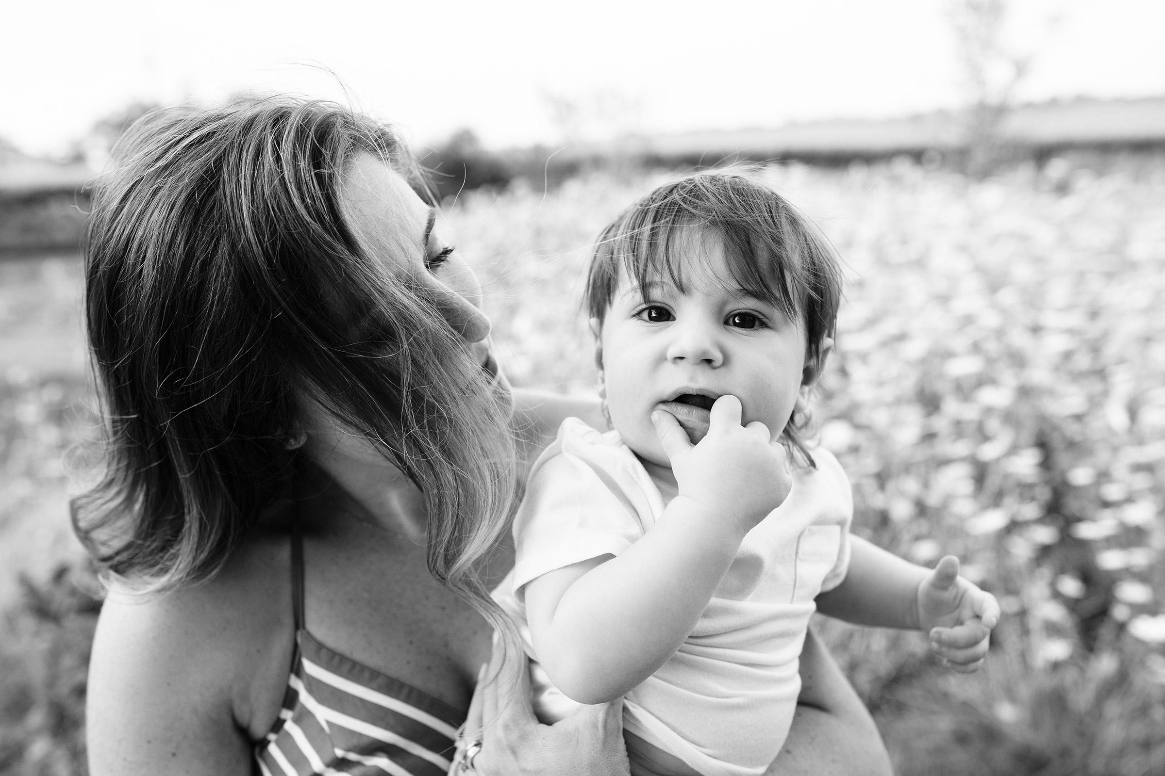 natale-family-mom-holding-son-black-and-white-iris-aisle--winterset-iowa-raelyn-ramey-photography-16.jpg
