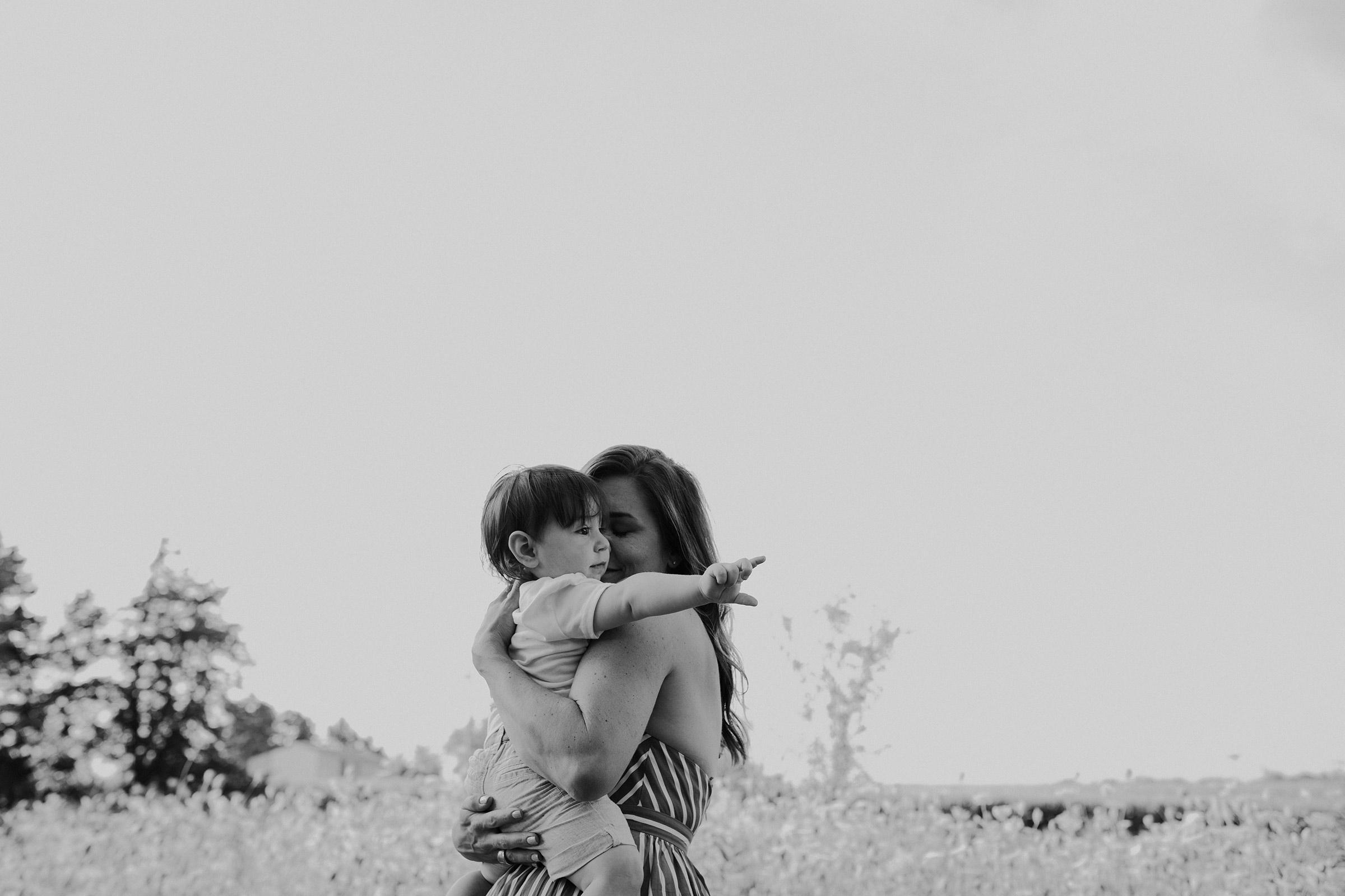 natale-family-mom-holding-son-tight-iris-aisle--winterset-iowa-raelyn-ramey-photography-55.jpg