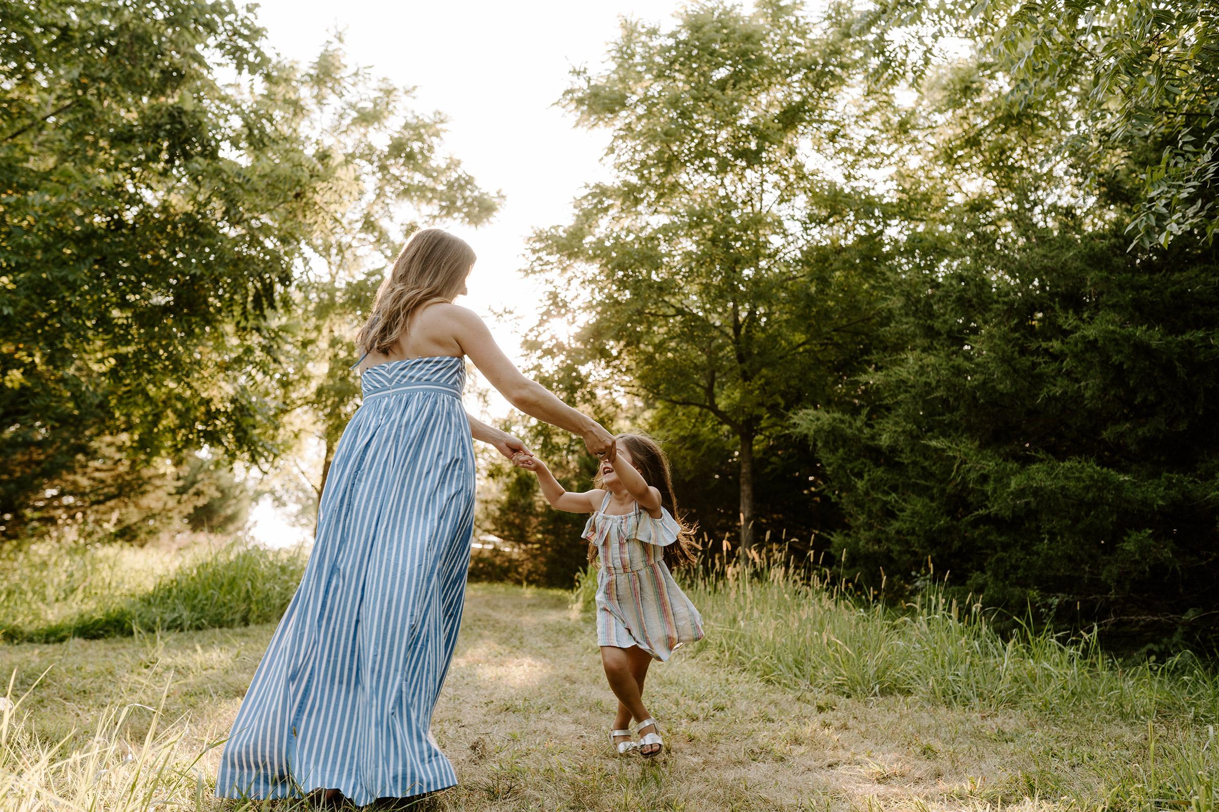 natale-family-mom-spinning-daughter-around-iris-aisle--winterset-iowa-raelyn-ramey-photography-112.jpg