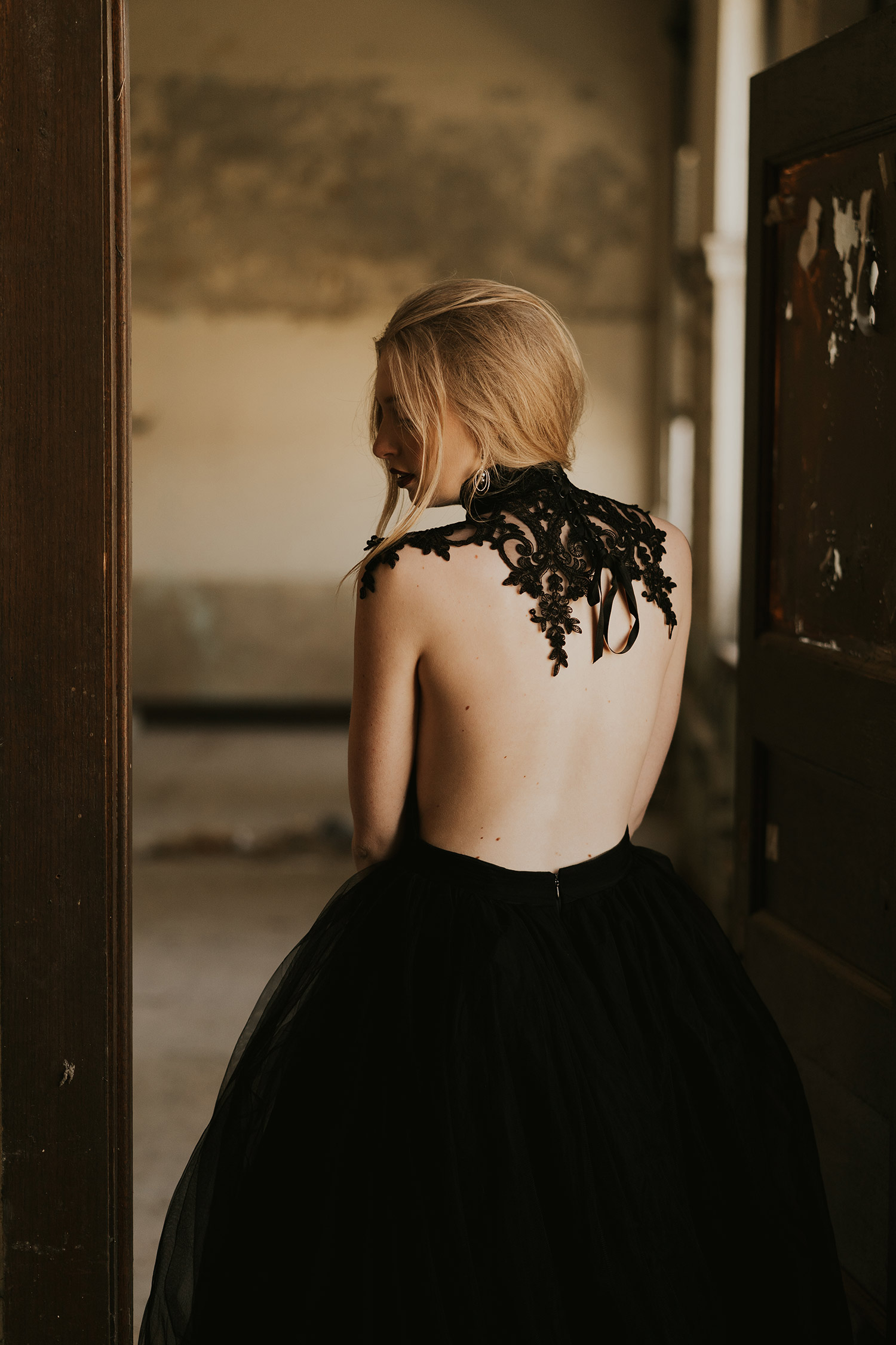 bride-showing-neck-piece-burlington-iowa-gothic-wedding-elopement-raelyn-ramey-photography-35.jpg