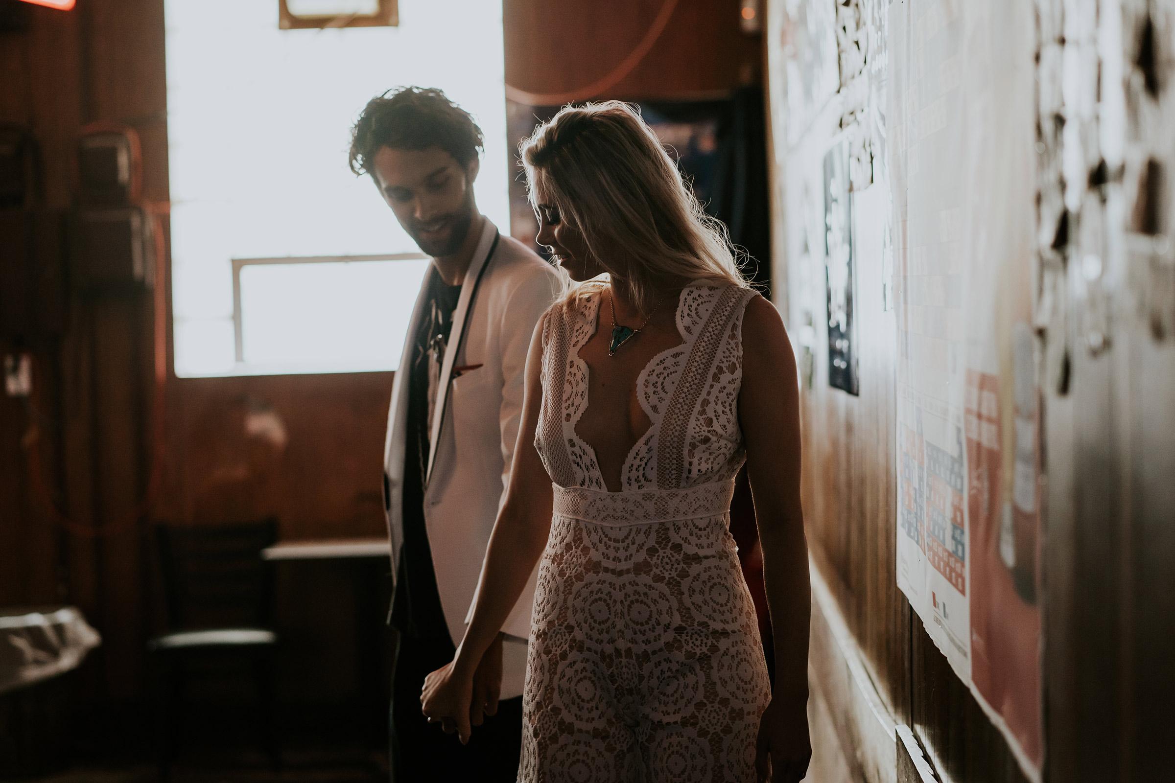 bride-and-groom-at-clarks-bar-iowa-road-trip-romance-wedding-raelyn-ramey-photography-99.jpg