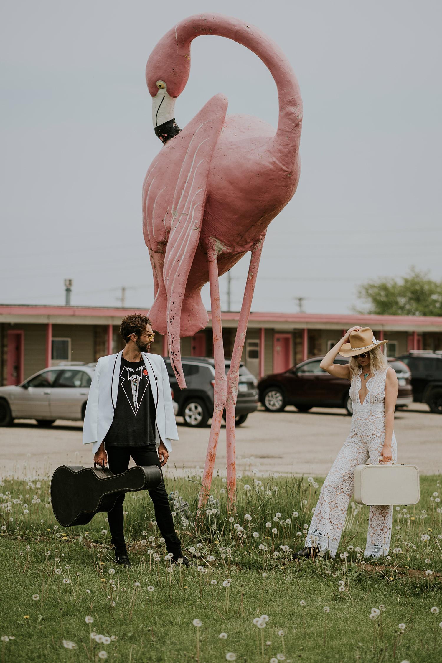 bride-groom-standing-by-flamingo-at-motel-iowa-road-trip-romance-wedding-raelyn-ramey-photography-134.jpg