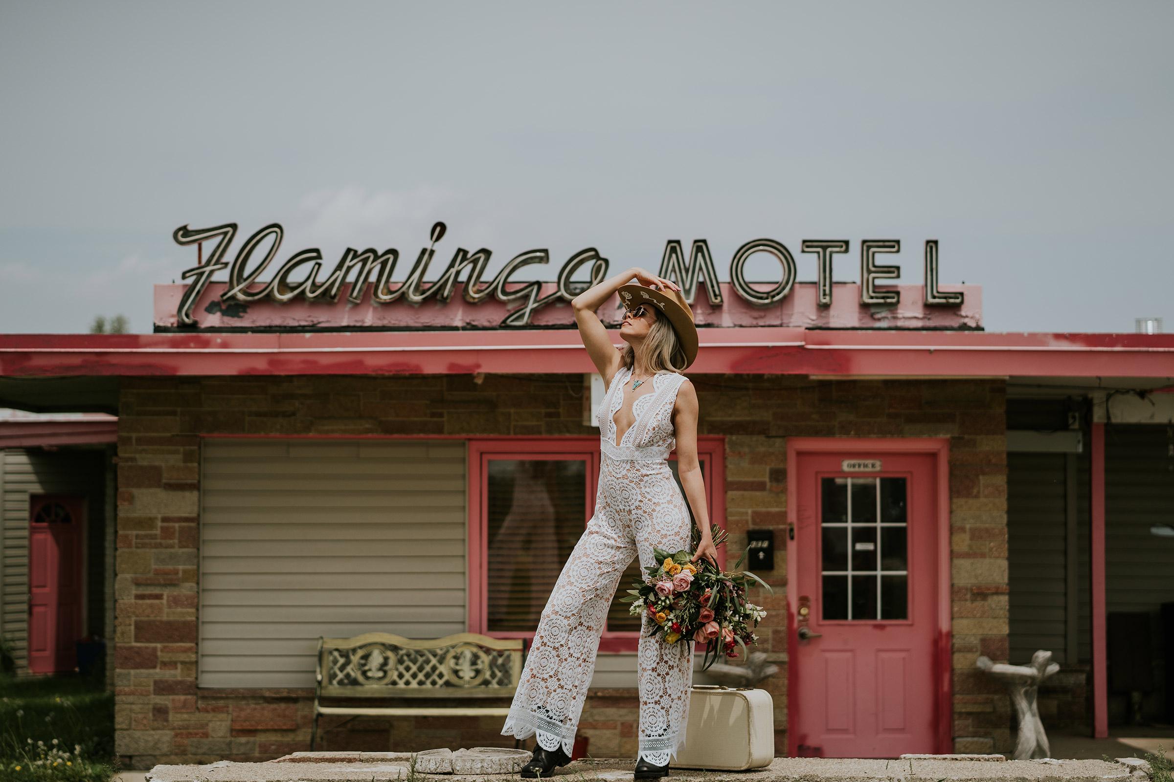 bride-wearing-dame-and-maien-designs-jumpsuit-at-flamingo-hotel-iowa-road-trip-romance-wedding-raelyn-ramey-photography-145.jpg