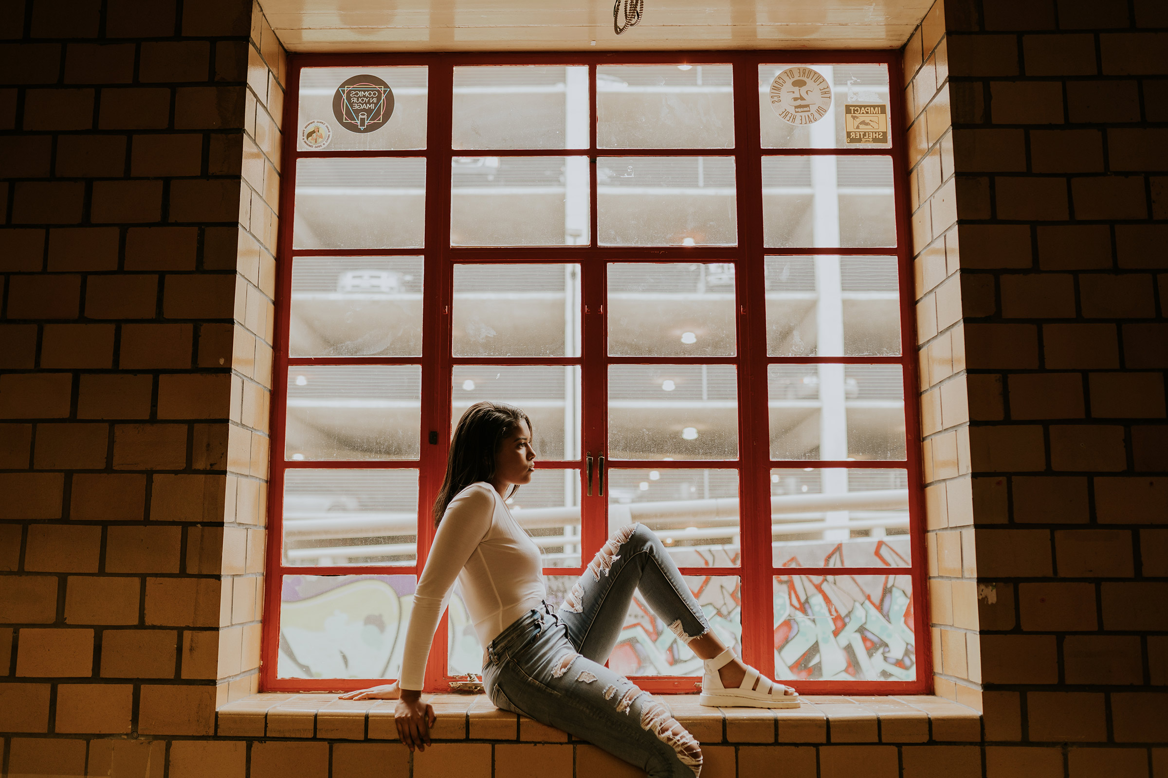 devina-girl-sitting-in-window-a-social-club-with-white-on-senior-roosevelt-high-school-desmoines-iowa-raelyn-ramey-photography-54.jpg