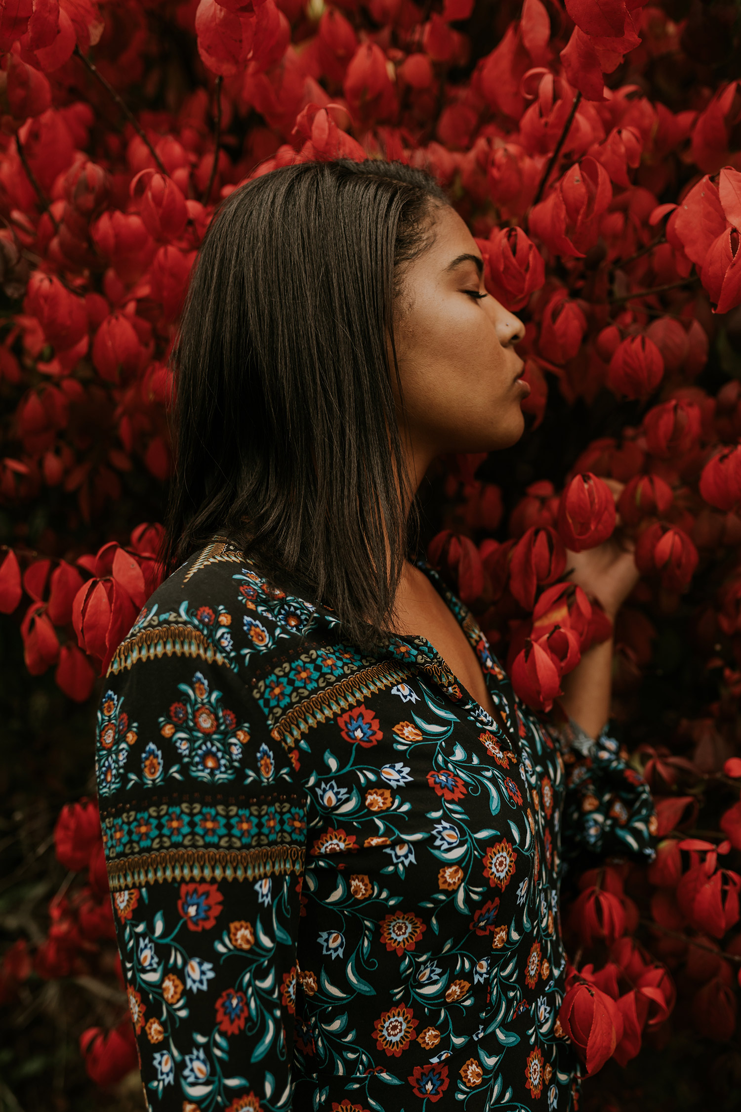 devina-girl-standing-with-red-leaves-senior-roosevelt-high-school-desmoines-iowa-raelyn-ramey-photography-134.jpg