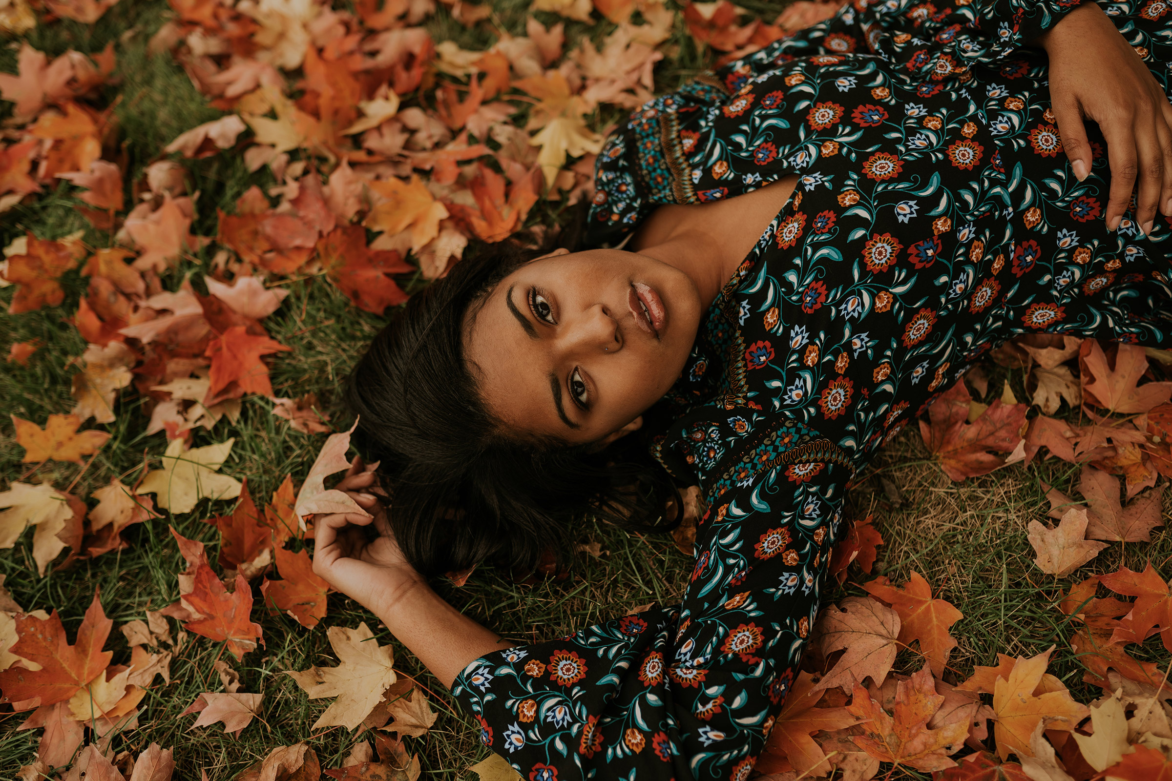 devina-girl-laying-in-fall-leaves-senior-roosevelt-high-school-desmoines-iowa-raelyn-ramey-photography-142.jpg