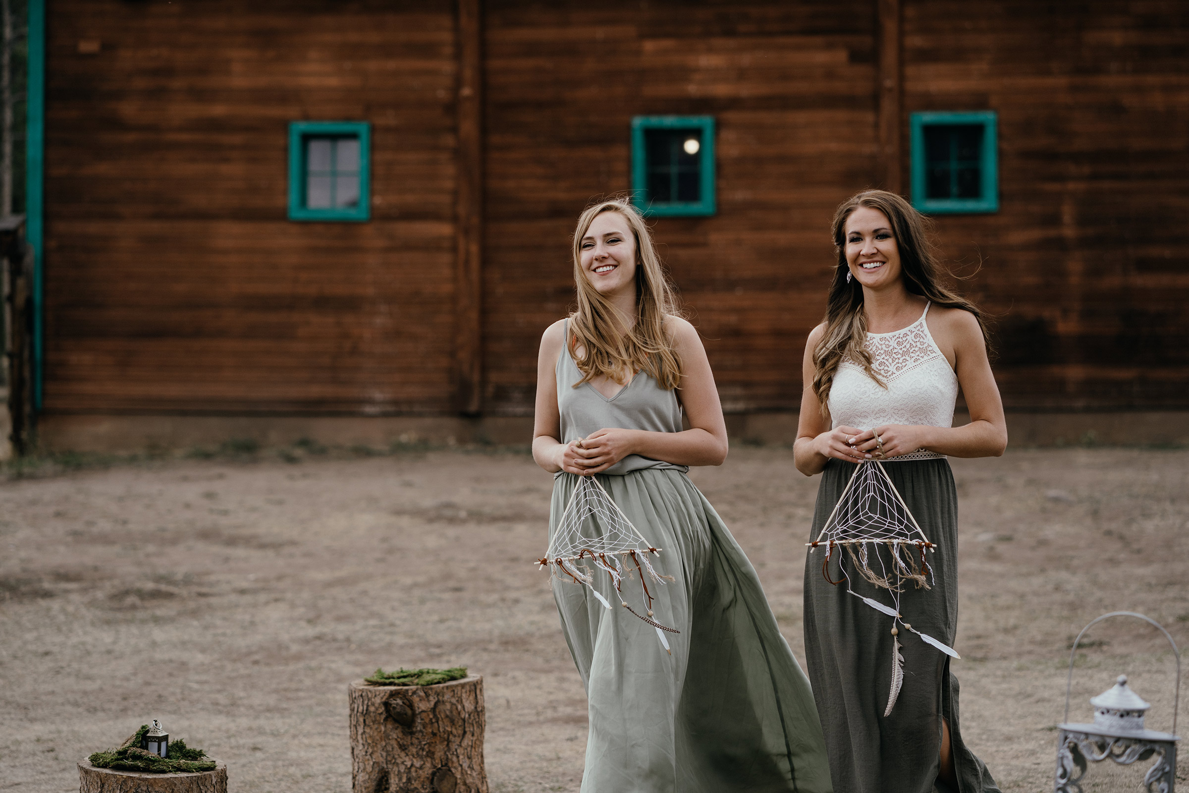 bidesmaids-holding-dream-catchers-walking-down-aisle-double-a-barn-grand-lake-colorado-raelyn-ramey-photography-413.jpg