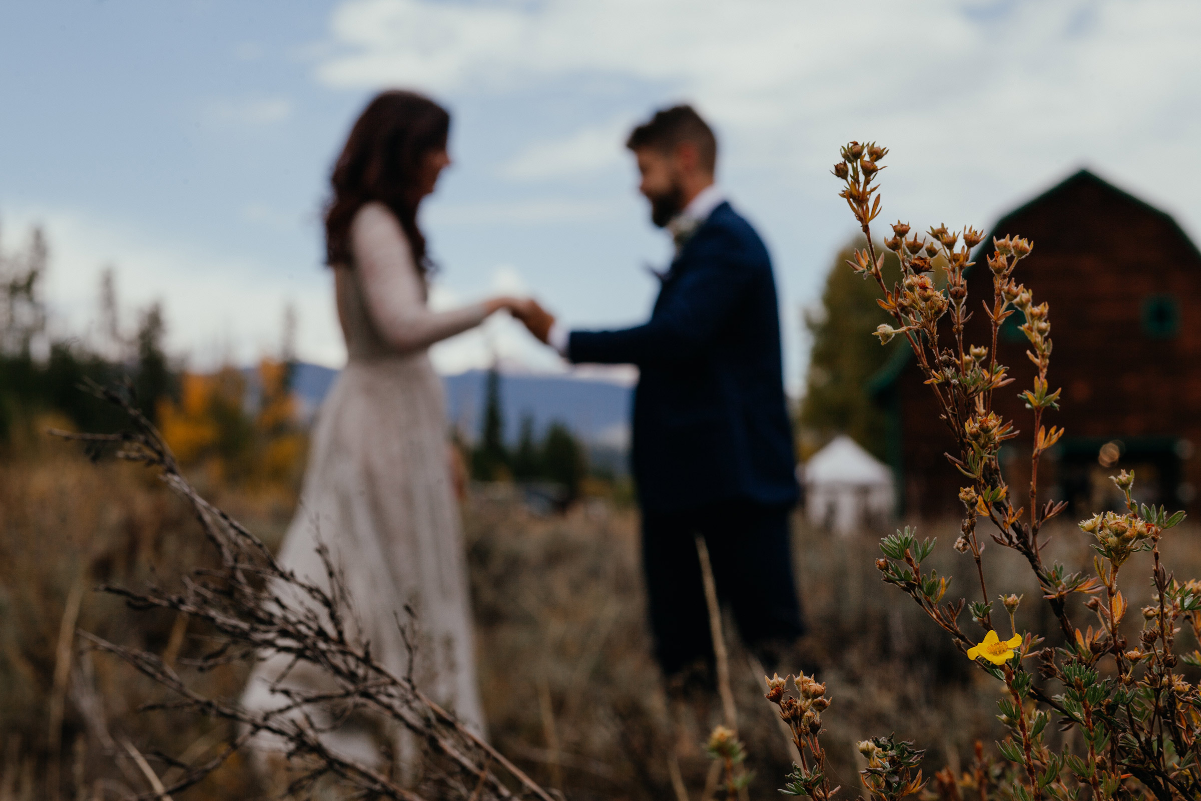 blurred-photo-of-bride-and-groom-holding-hands-double-a-barn-grand-lake-colorado-raelyn-ramey-photography-380.jpg