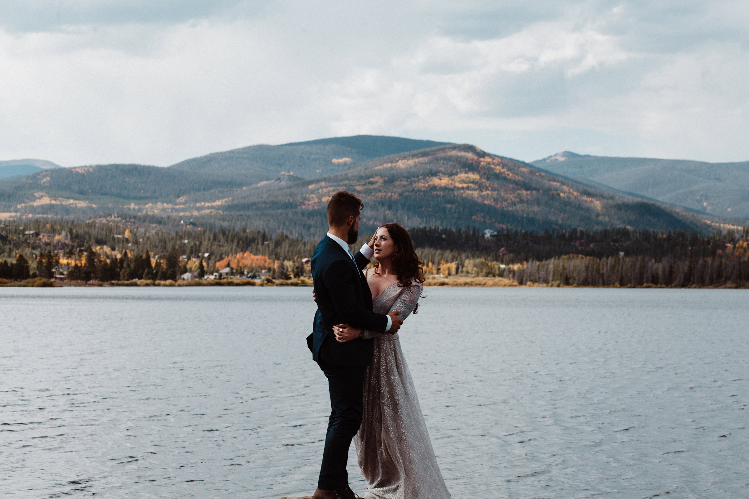 bride-and-groom-looking-at-each-other-close-with-mountains-behind-them-double-a-barn-grand-lake-colorado-raelyn-ramey-photography-490.jpg