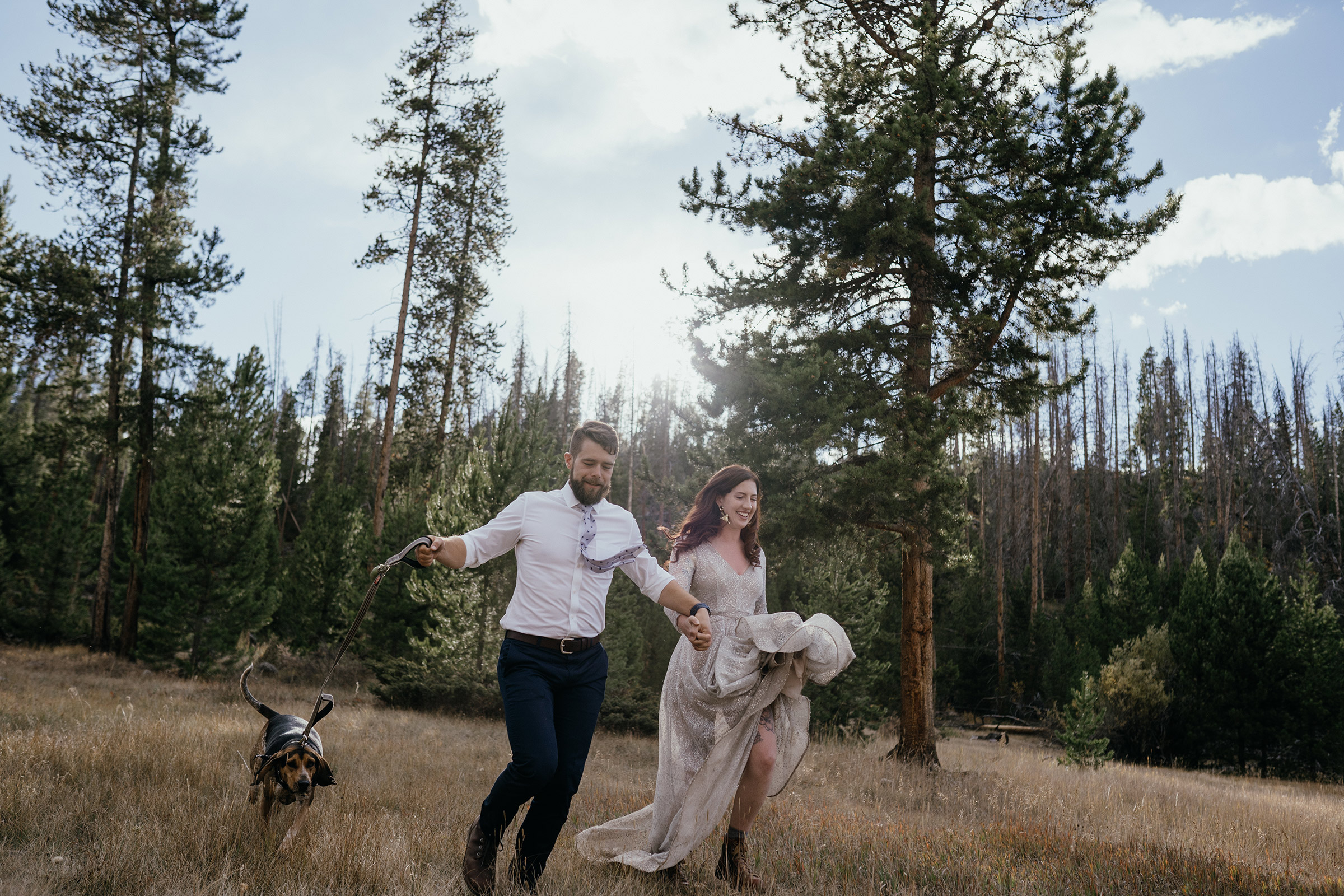bride-groom-running-with-dog-double-a-barn-grand-lake-colorado-raelyn-ramey-photography-589.jpg