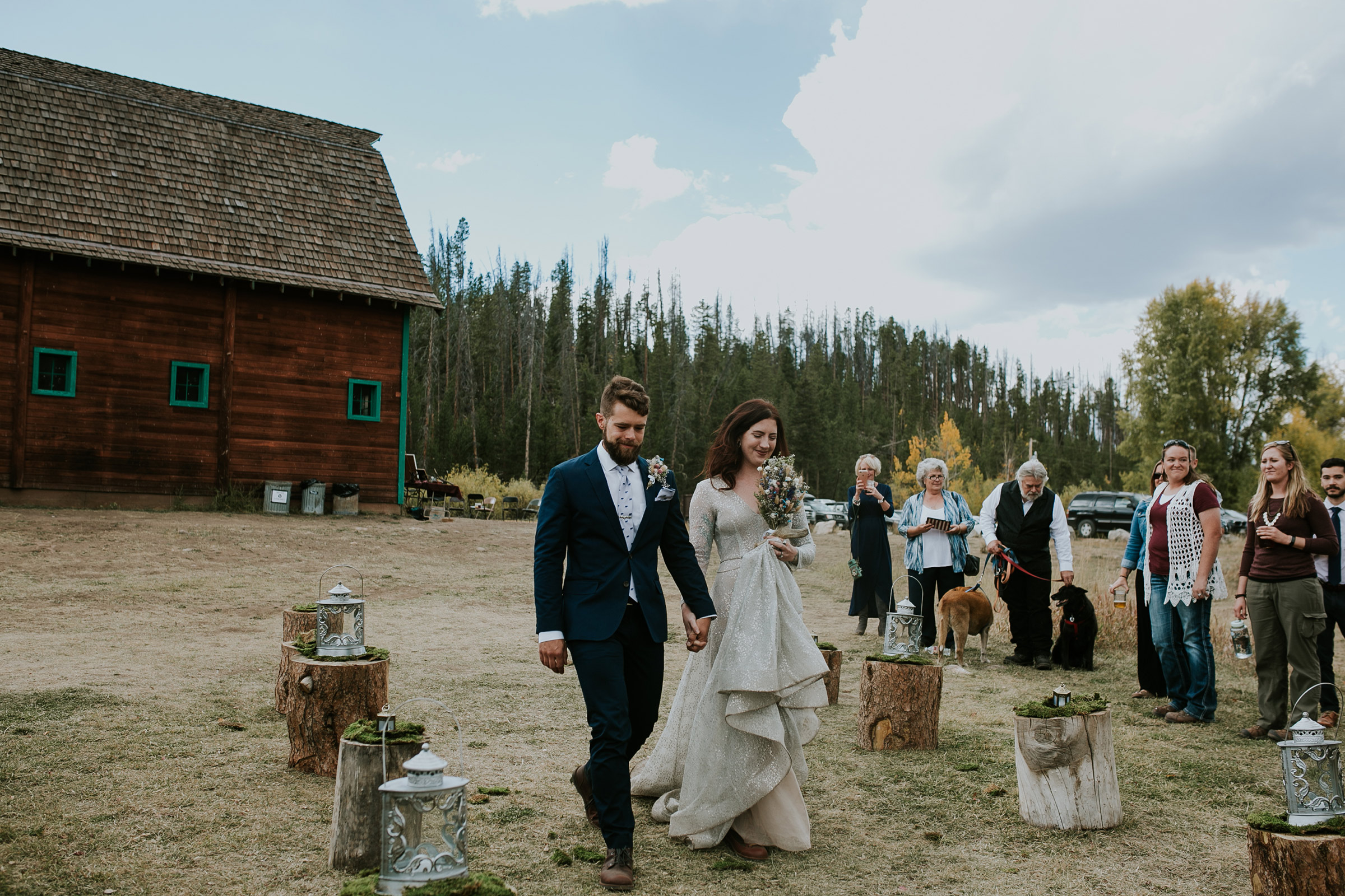 bride-groom-walking-down-the-aisle-double-a-barn-grand-lake-colorado-raelyn-ramey-photography-418.jpg