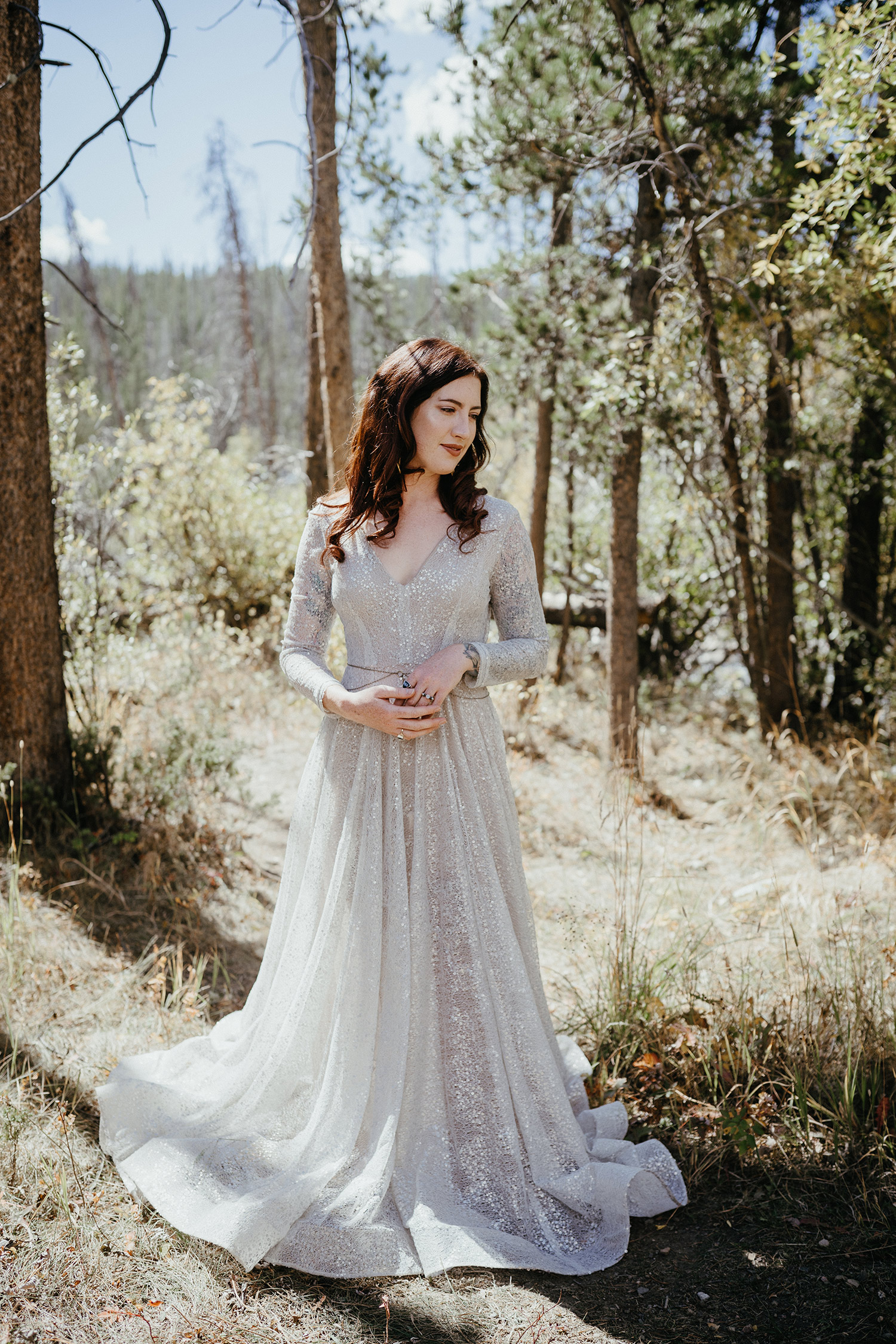 bride-wearing-gown-in-woods-double-a-barn-grand-lake-colorado-raelyn-ramey-photography-186.jpg
