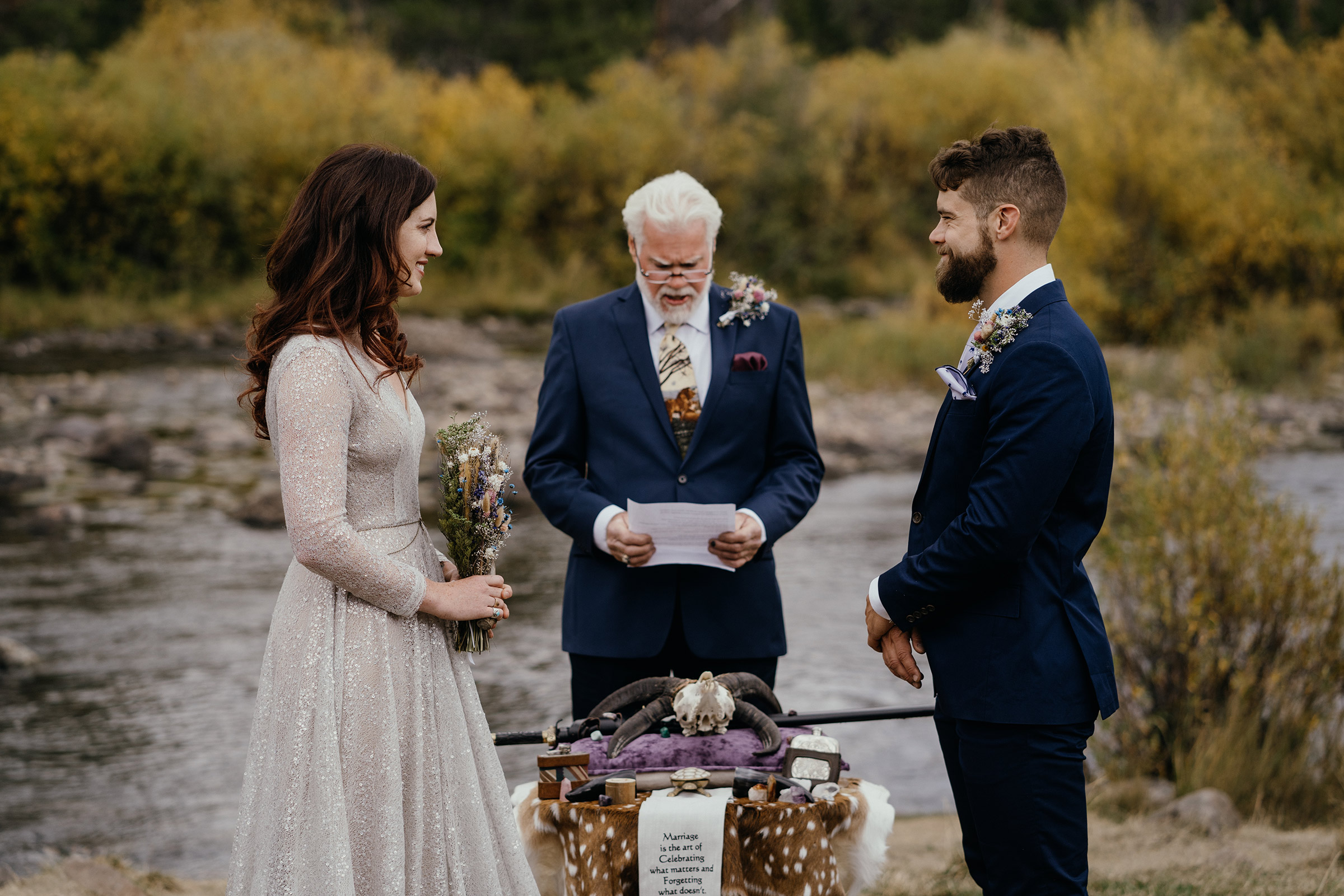 brides-dad-reading-poem-during-ceremony-double-a-barn-grand-lake-colorado-raelyn-ramey-photography-420.jpg