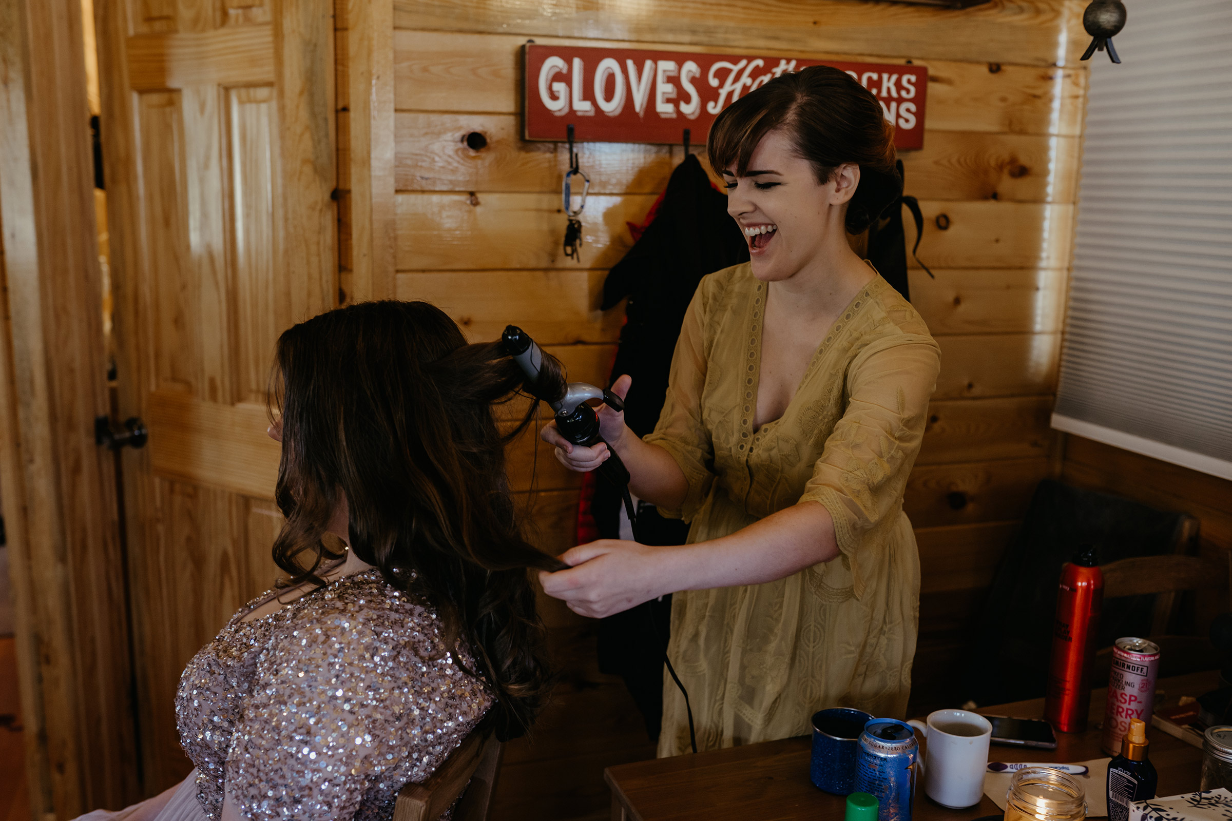 bridesmaid-doing-hair-laughing-lupine-village-grand-lake-colorado-raelyn-ramey-photography-19.jpg