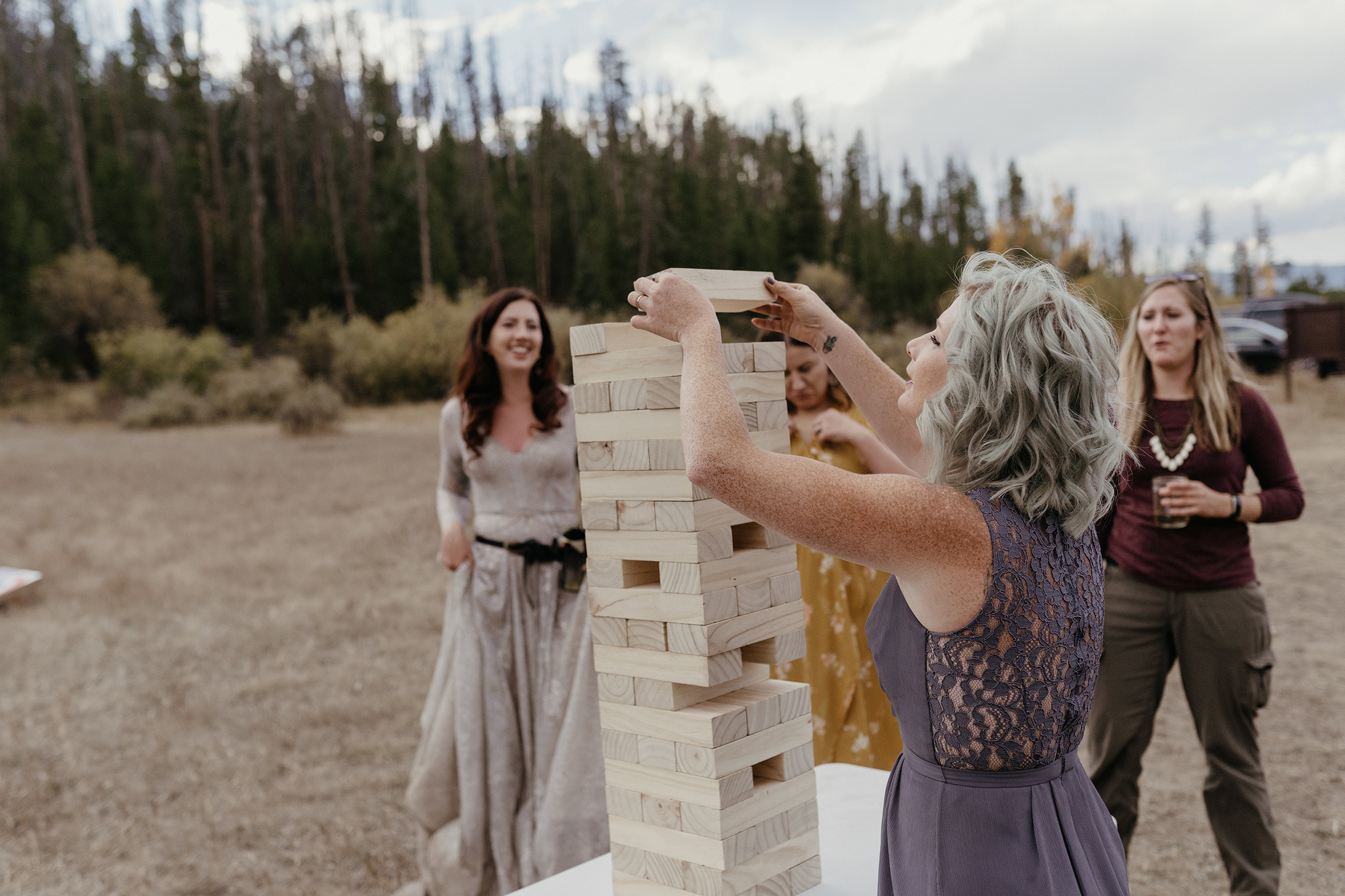 bridesmaid-playing-jenga-double-a-barn-grand-lake-colorado-raelyn-ramey-photography-727.jpg