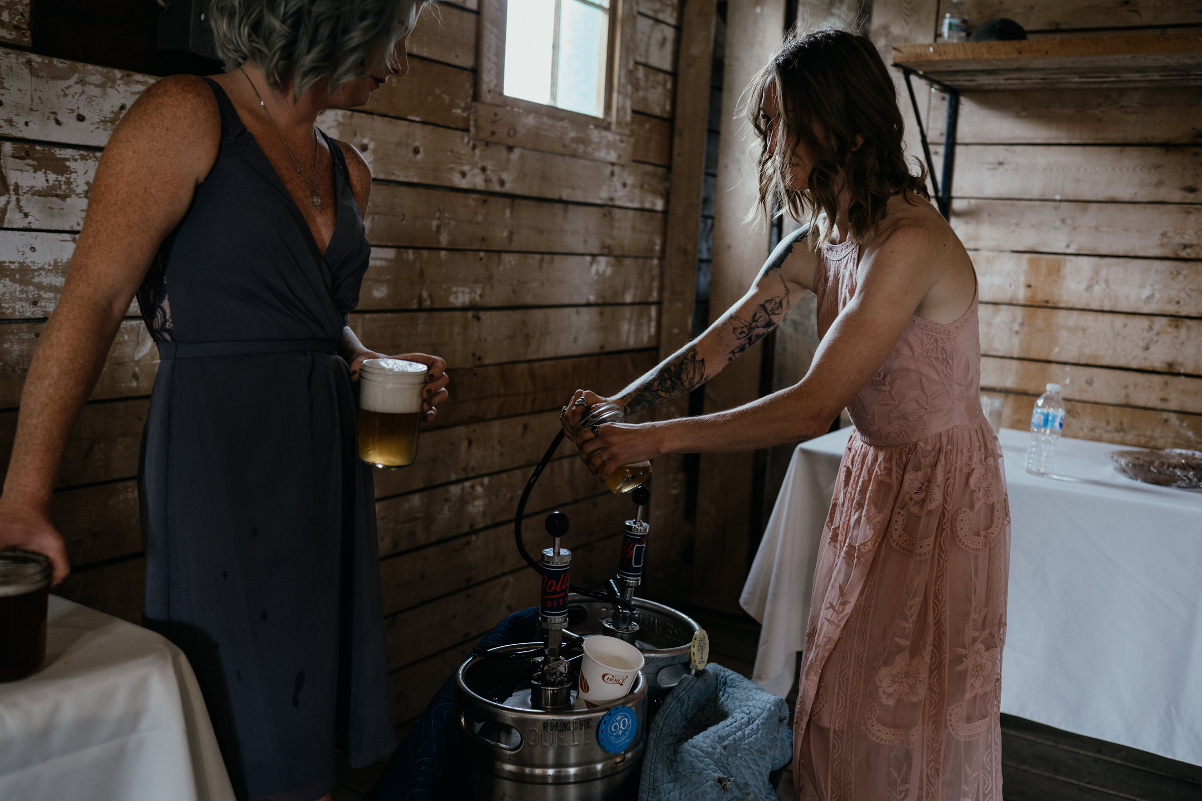 bridesmaid-tapping-keg-double-a-barn-grand-lake-colorado-raelyn-ramey-photography-398.jpg
