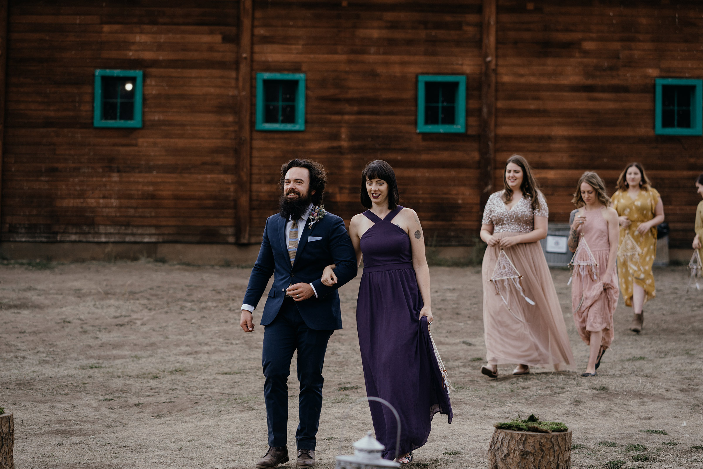 bridesmaides-and-groomsmen-walking-down-aisle-double-a-barn-grand-lake-colorado-raelyn-ramey-photography-410.jpg