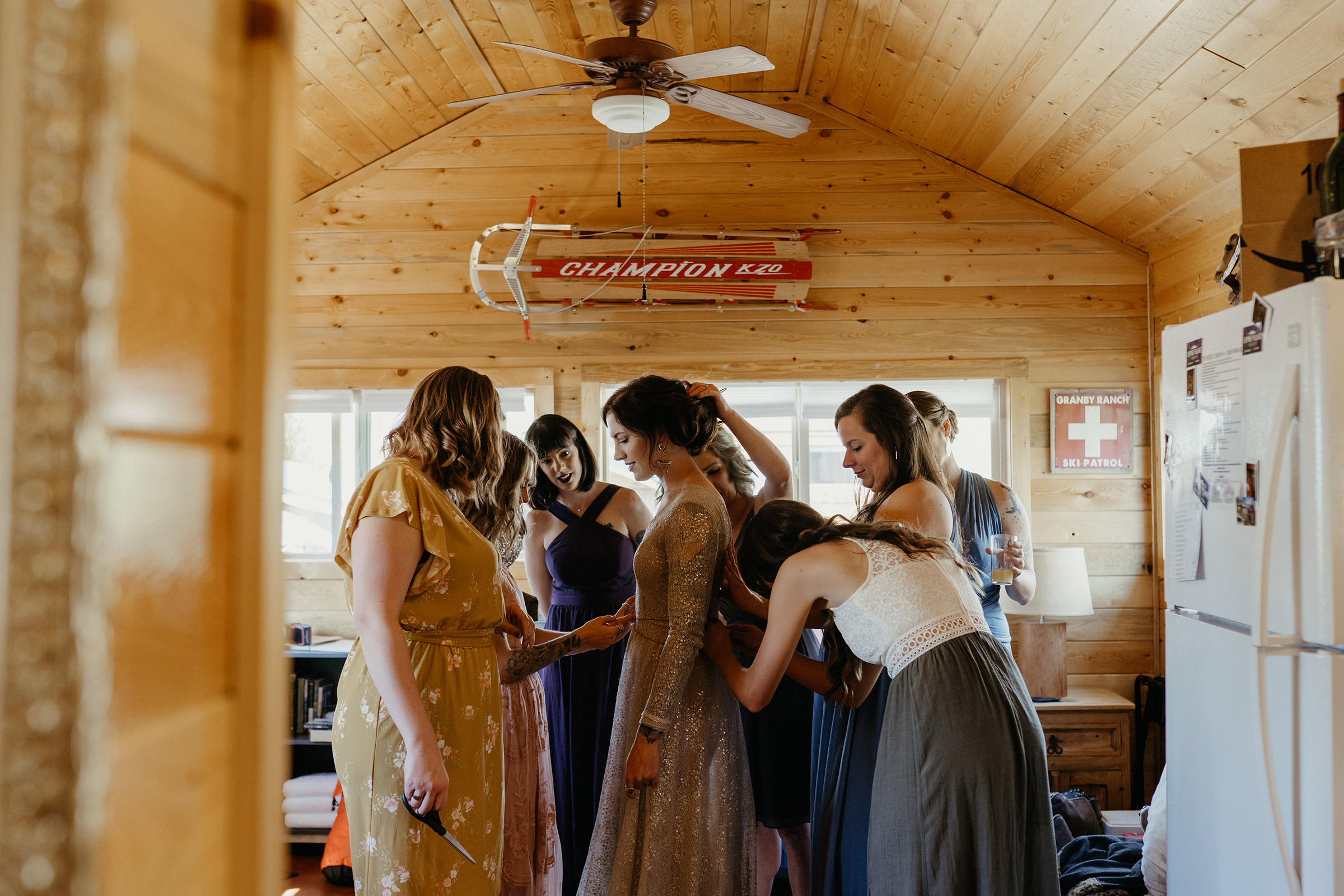 bridesmaids-helping-bride-get-ready-lupine-village-double-a-barn-grand-lake-colorado-raelyn-ramey-photography-50.jpg