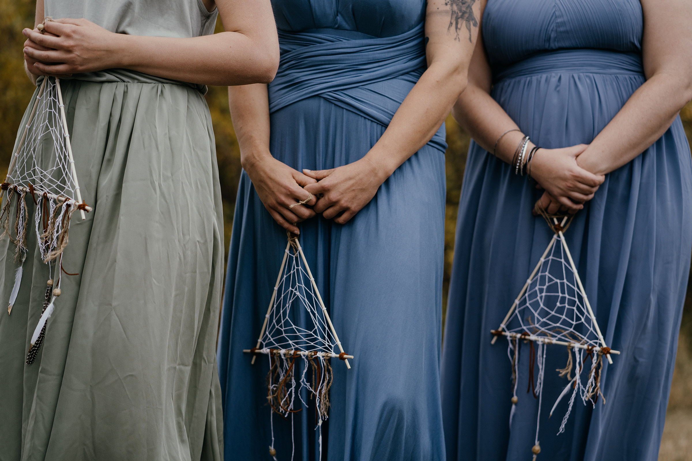 bridesmaids-holding-dream-catchers-double-a-barn-grand-lake-colorado-raelyn-ramey-photography-427.jpg