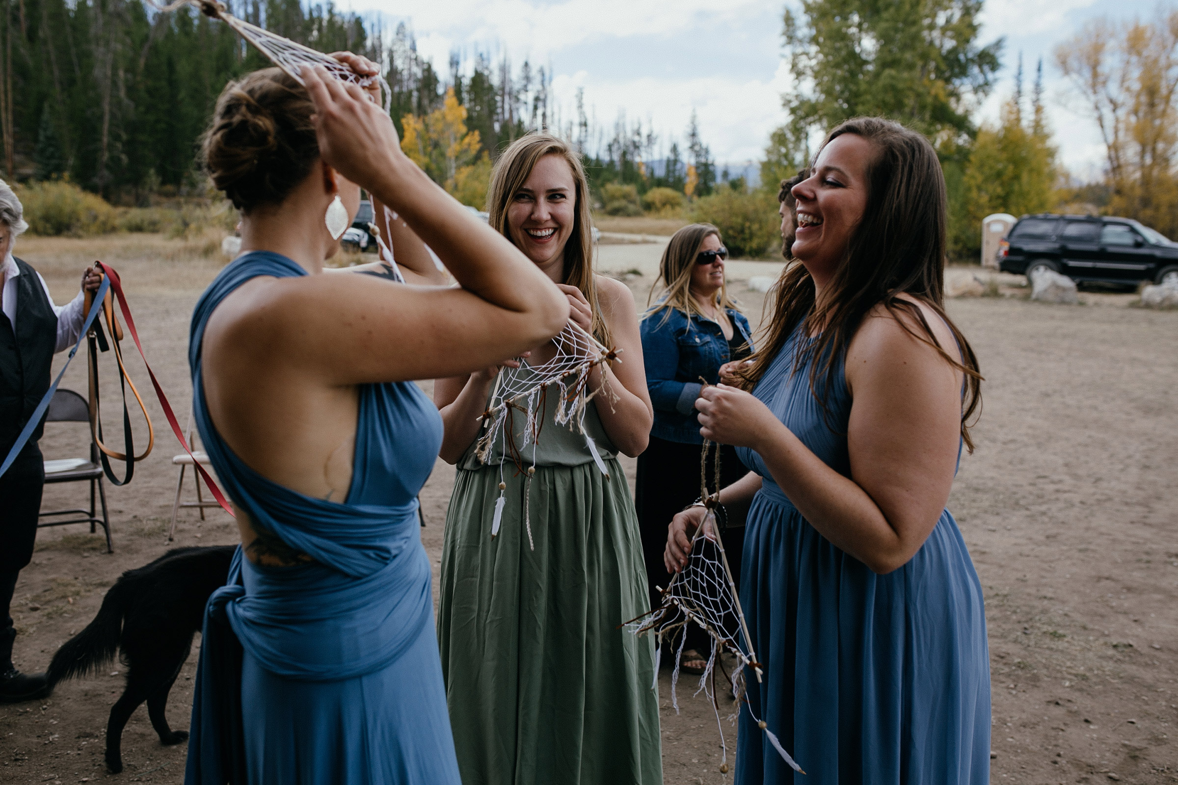 bridesmaids-laughing-about-dream-catchers-double-a-barn-grand-lake-colorado-raelyn-ramey-photography-401.jpg