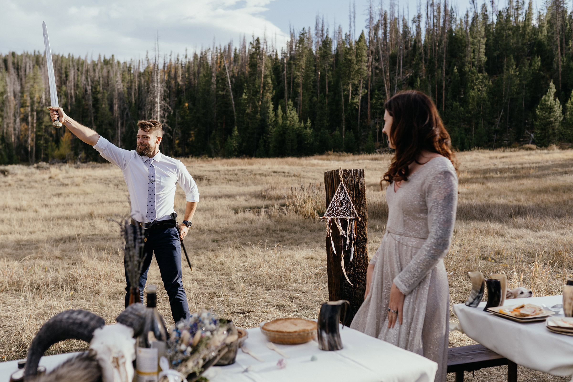 groom-holding-sword-in-the-air-double-a-barn-grand-lake-colorado-raelyn-ramey-photography-608.jpg