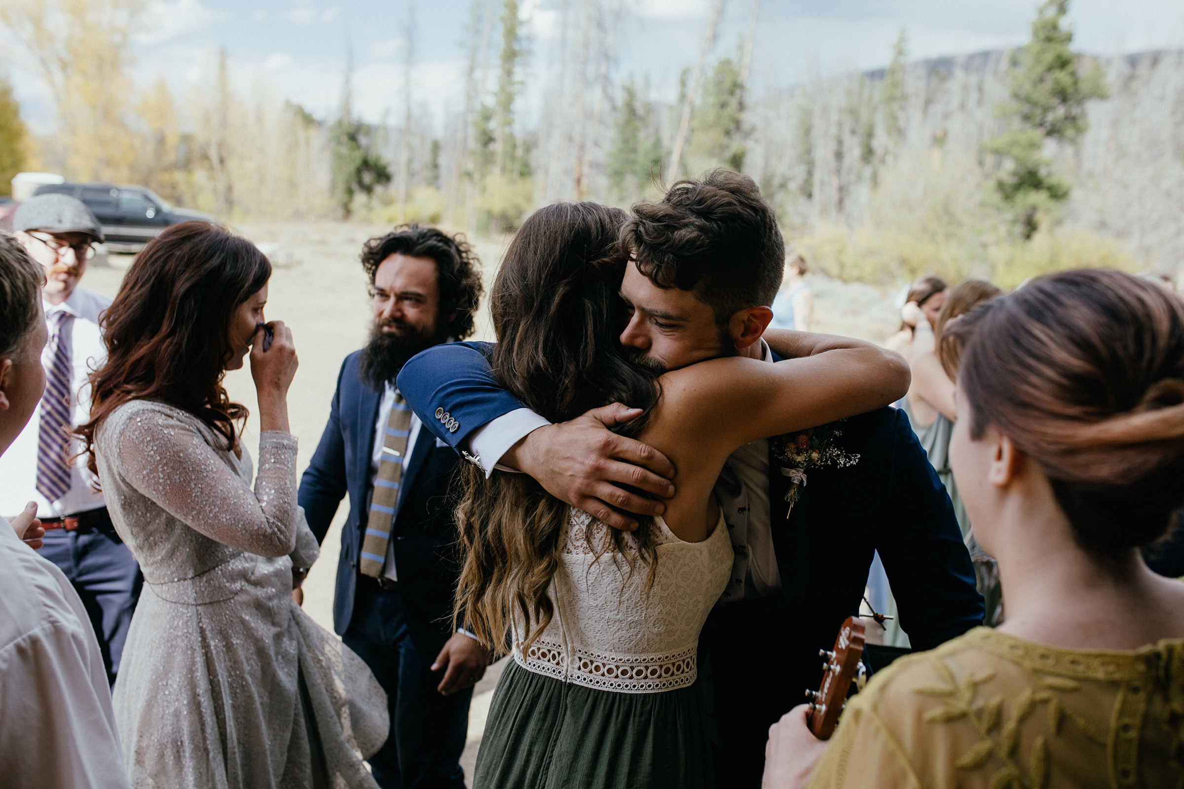 groom-hugging-wedding-guest-after-ceremony-double-a-barn-grand-lake-colorado-raelyn-ramey-photography-463.jpg