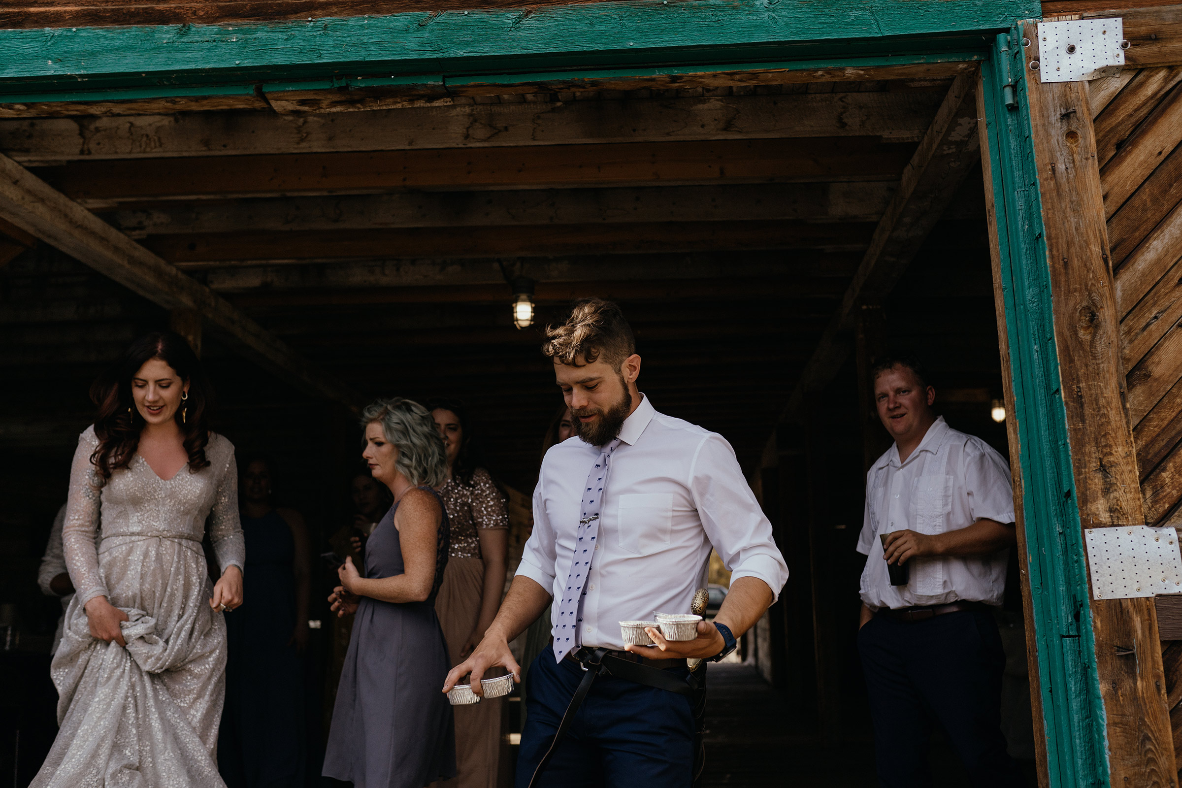groom-passing-out-pie-double-a-barn-grand-lake-colorado-raelyn-ramey-photography-594.jpg
