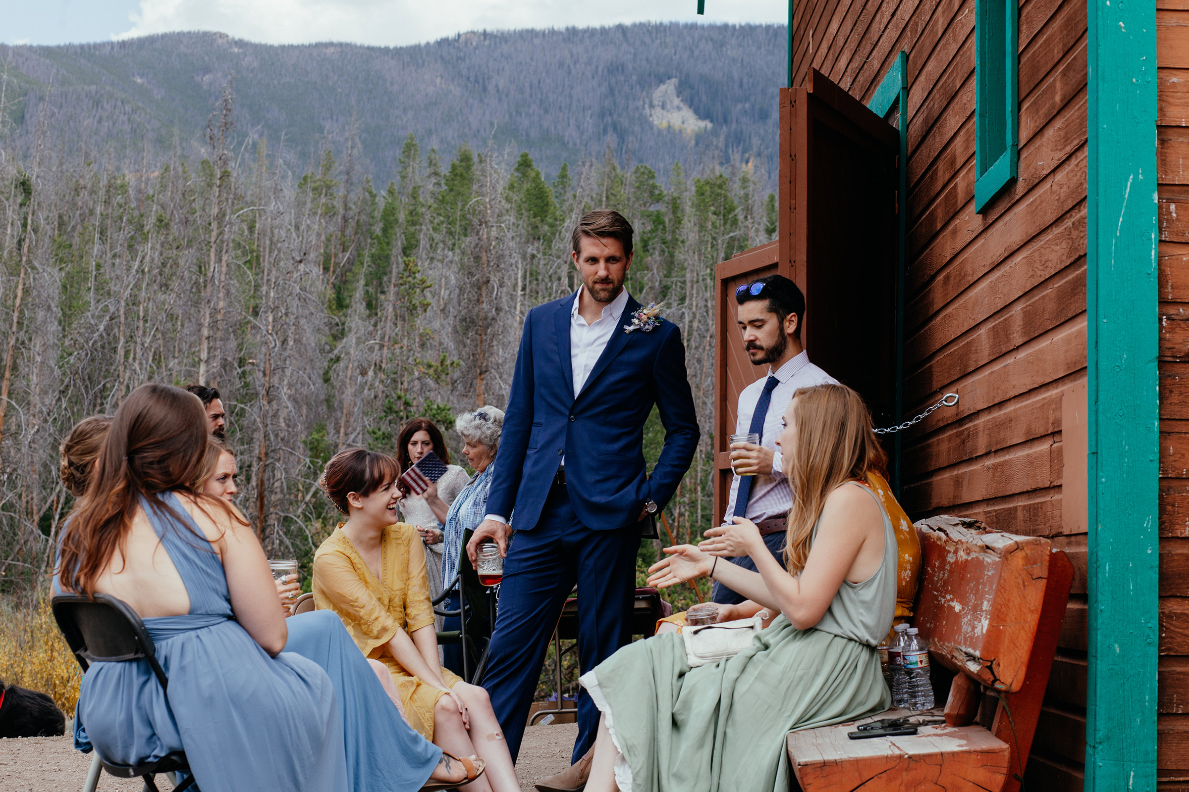 groomsmen-talking-to-bridesmaids-at-wedding-double-a-barn-grand-lake-colorado-raelyn-ramey-photography-355.jpg