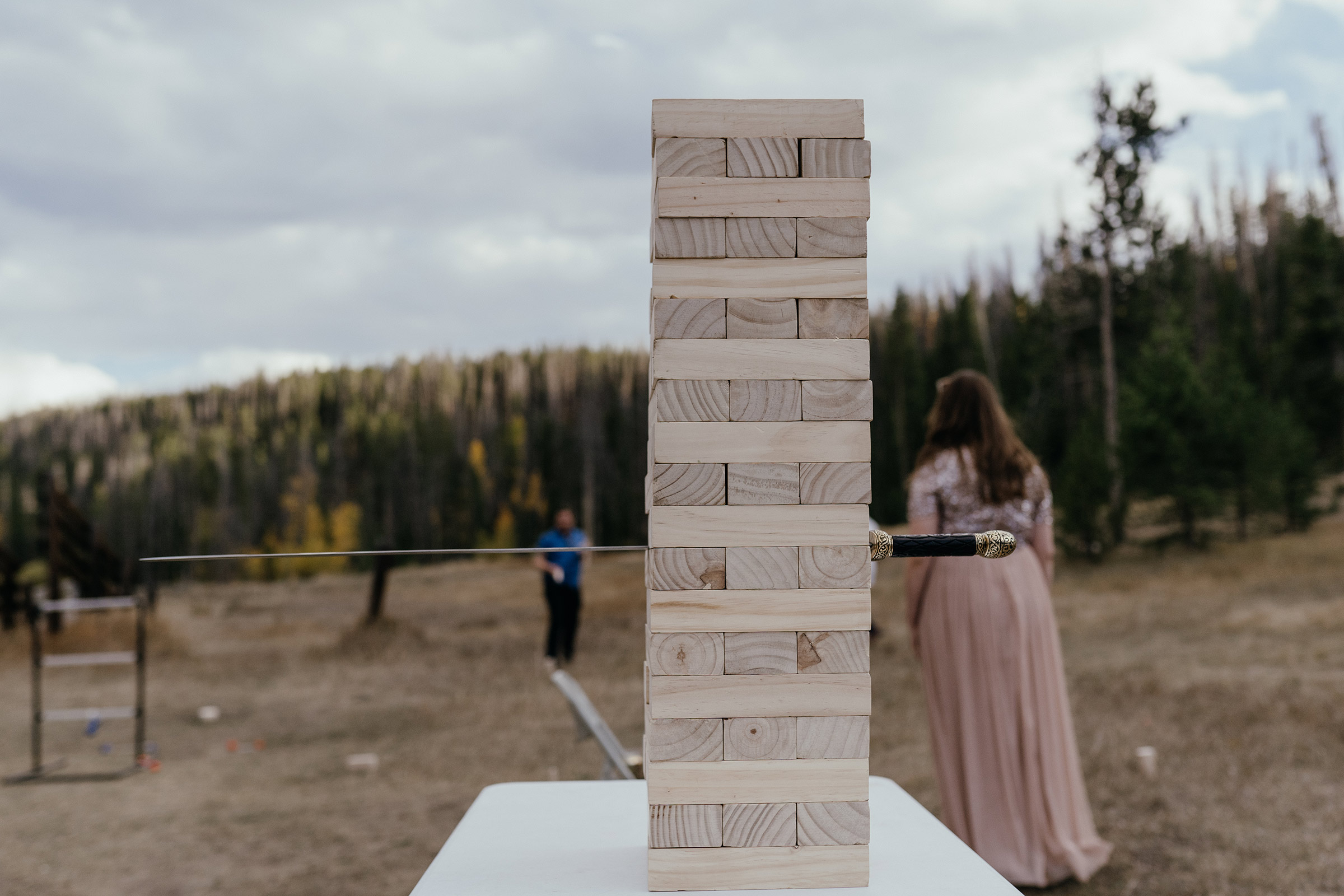 sword-through-jenga-game-double-a-barn-grand-lake-colorado-raelyn-ramey-photography-725.jpg