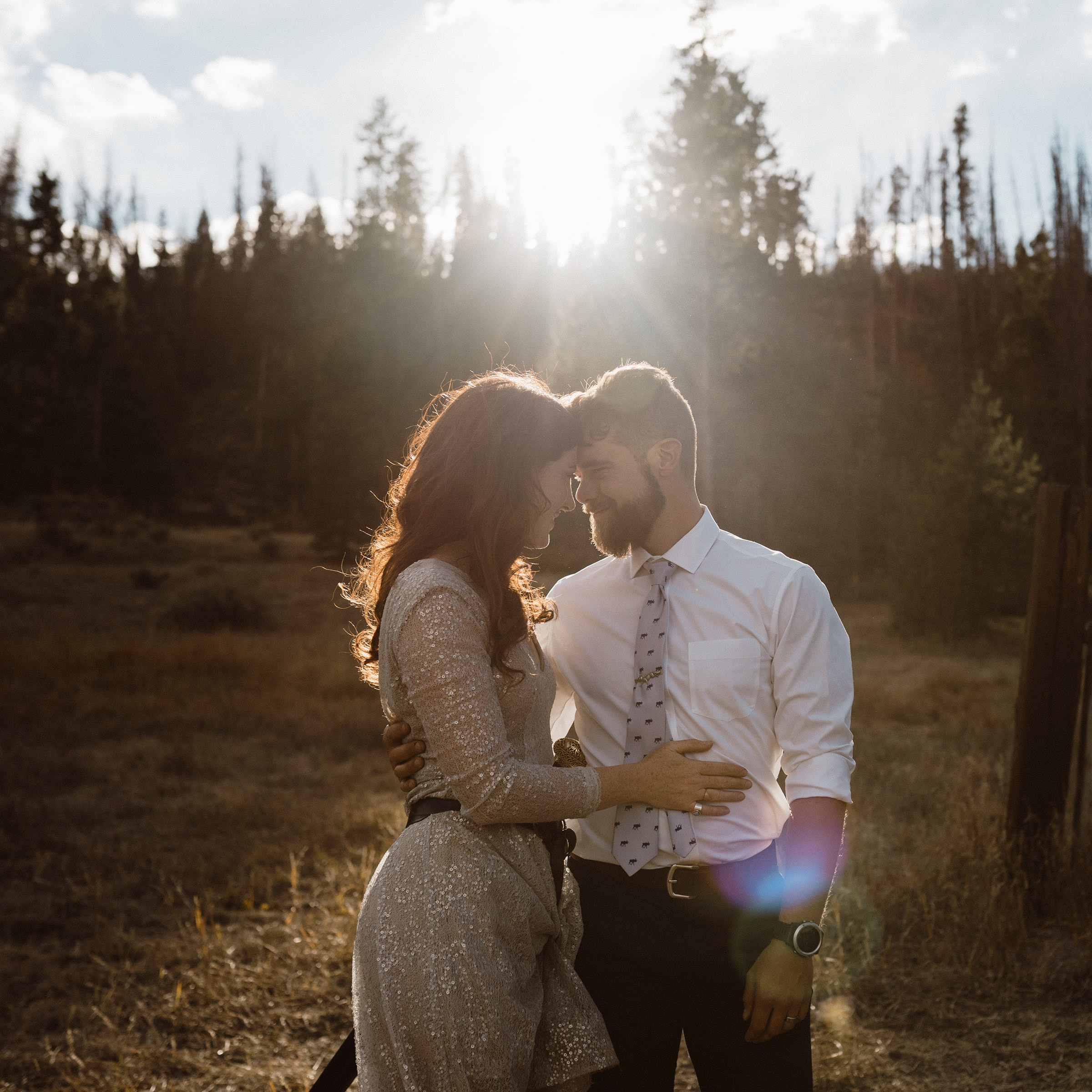 wedding-couple-holding-each-other-in-sun-light-grand-lake-colorado-raelyn-ramey-photography-654.jpg
