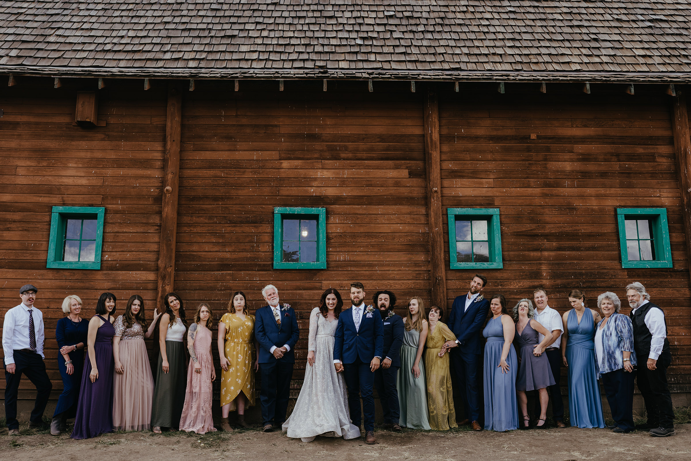 wedding-party-standing-in-line-double-a-barn-grand-lake-colorado-raelyn-ramey-photography-305.jpg