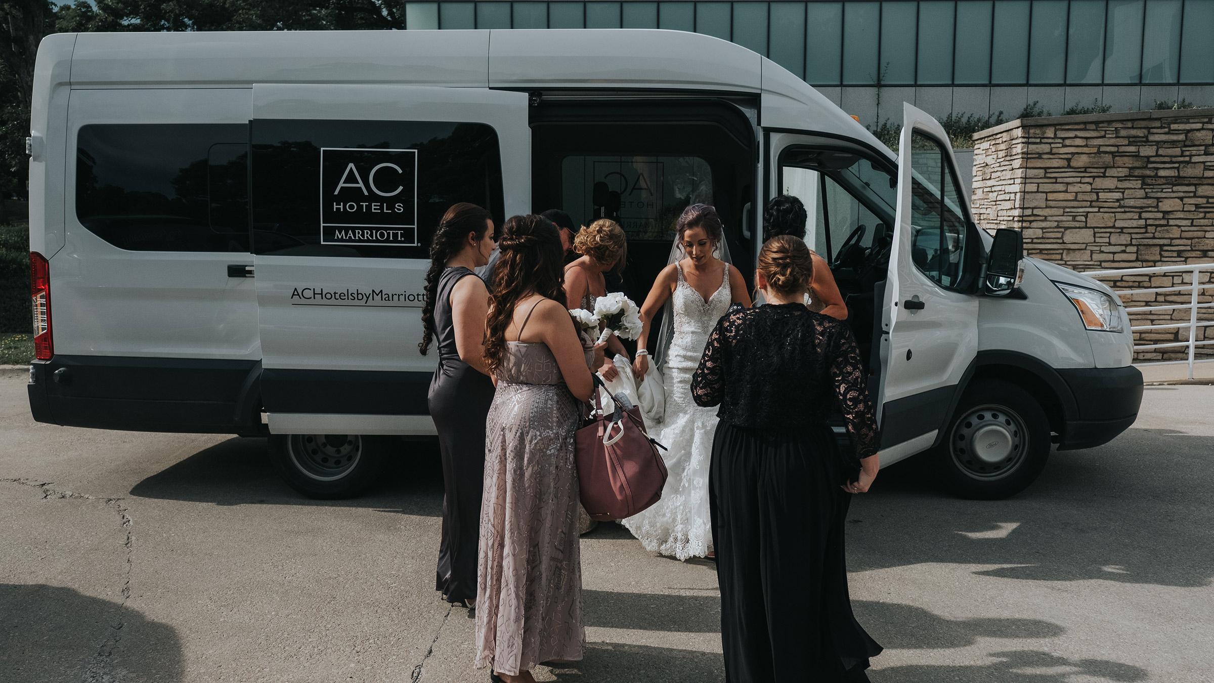 bride-and-bridesmaids-arriving-ceremony-desmoines-iowa-rose-garden-raelyn-ramey-photography.jpg