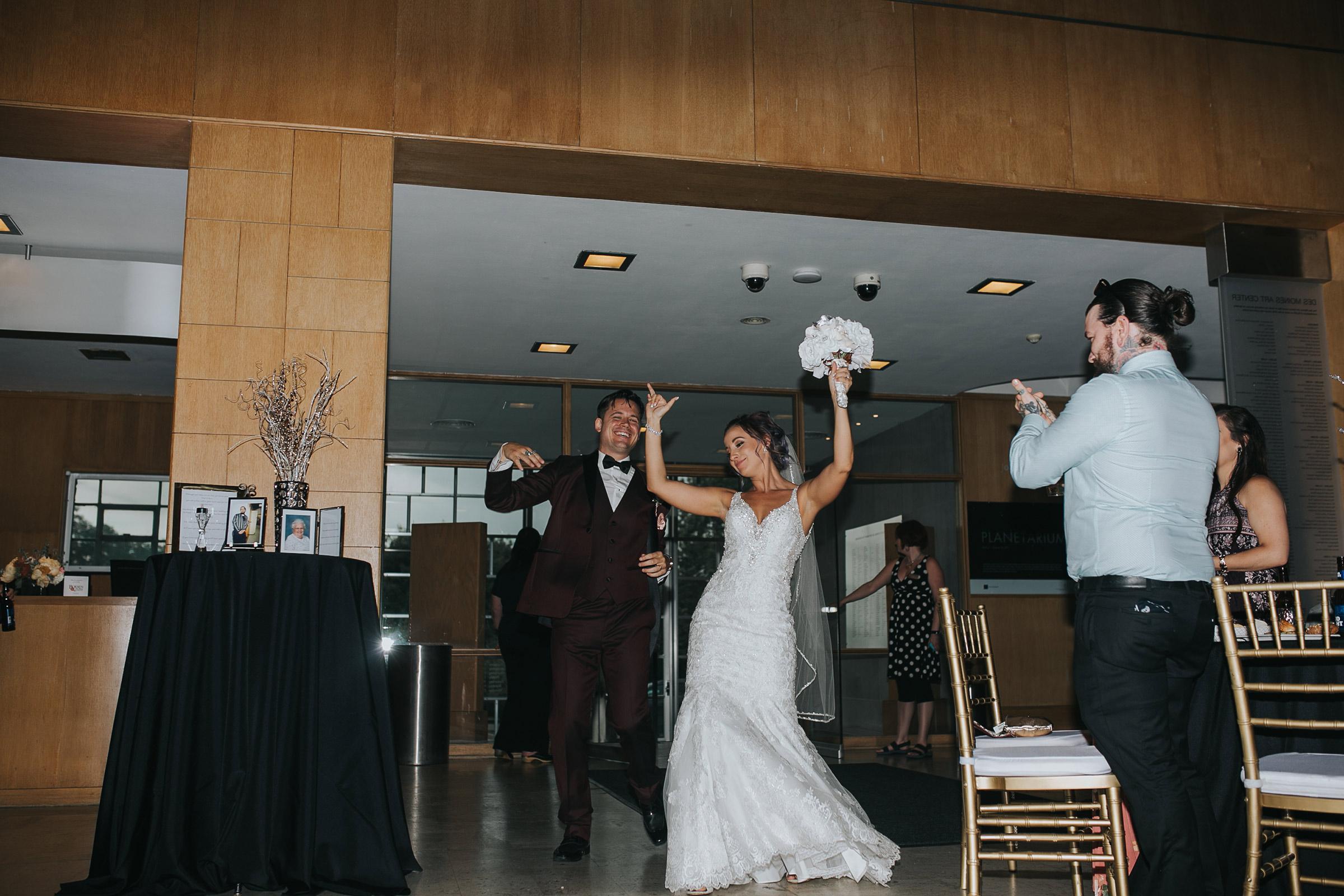bride-and-groom-grand-enterance-desmoines-iowa-art-center-raelyn-ramey-photography.jpg