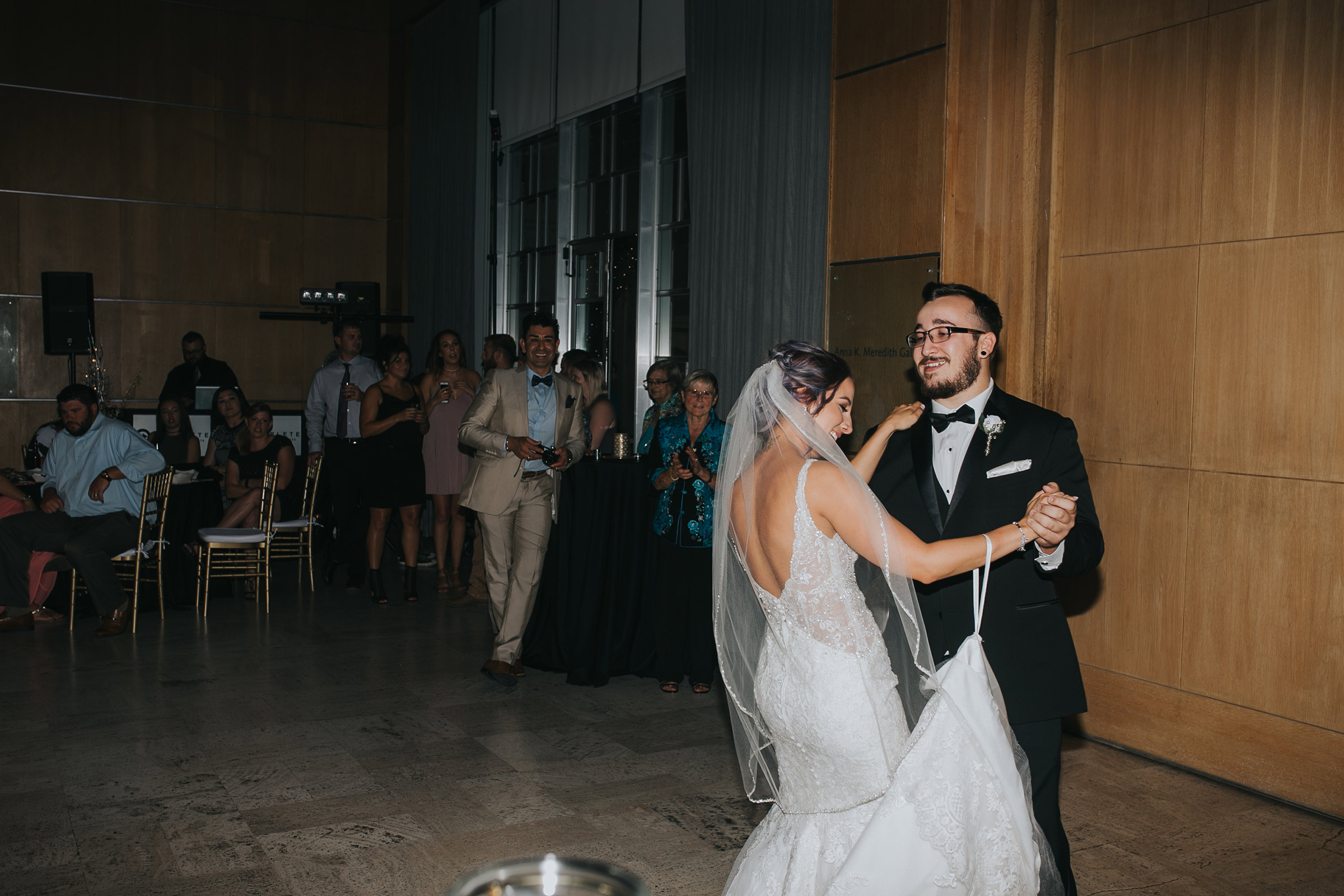 bride-dancing-with-brother-desmoines-iowa-art-center-raelyn-ramey-photography.jpg